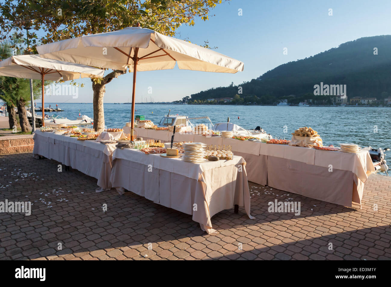 catering and wedding party on the sea - Stock Image