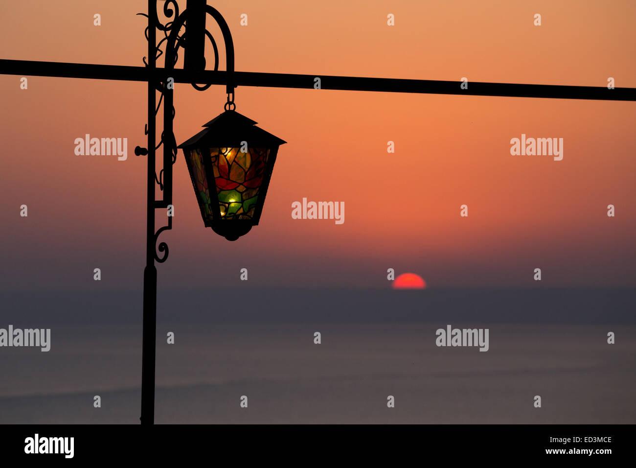 Nostalgic Reminiscence with stained glass lantern at sunset at Kaliakra headland, Black Sea Coast - Stock Image