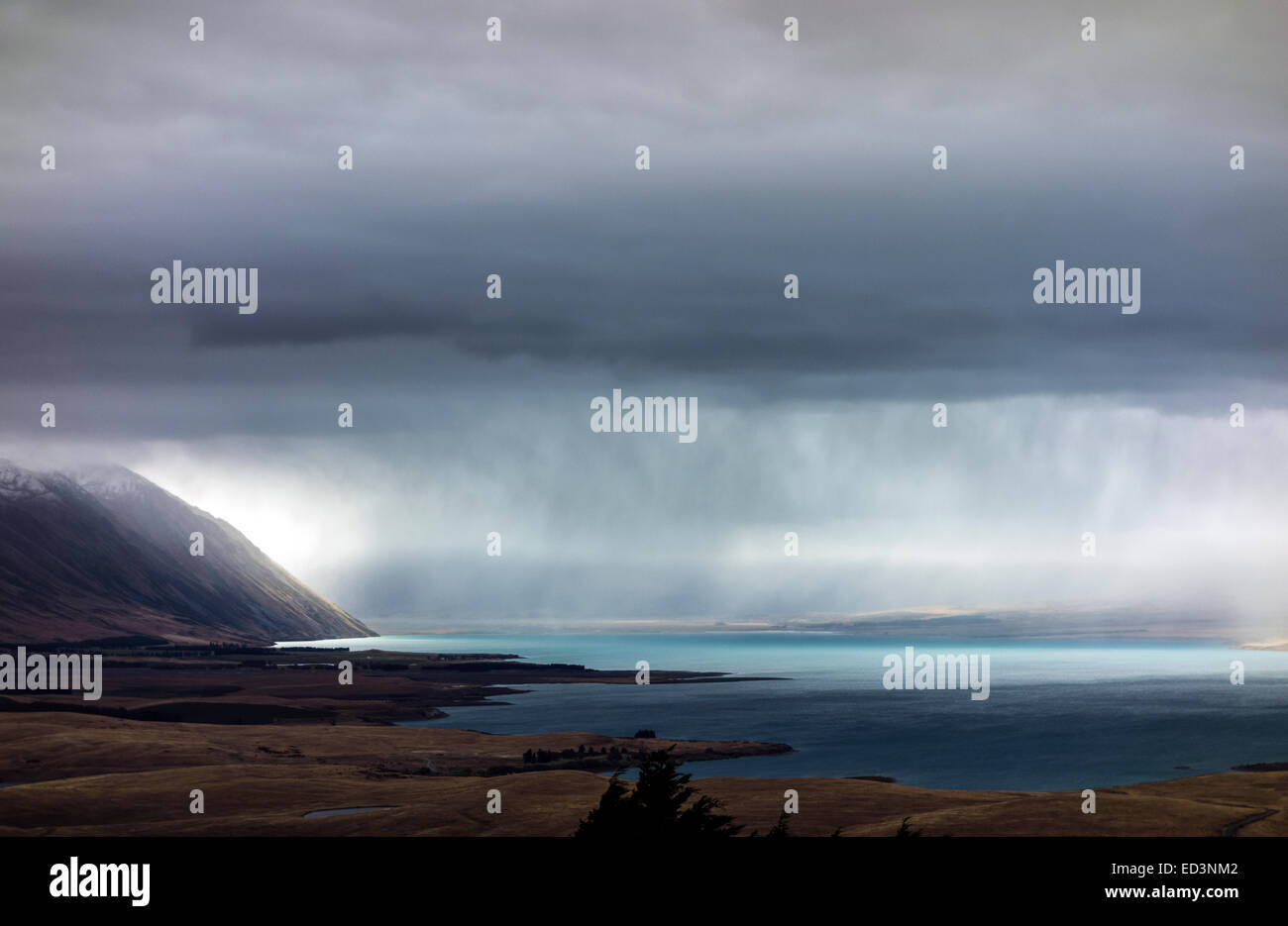Lake Tekapo overview in bad weather, summer rain storm. Scenic view from Mount John University Observatory. New - Stock Image