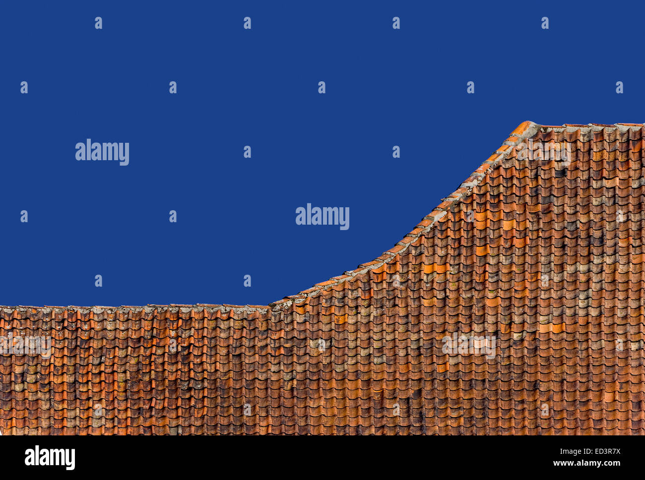 Old roof ridge, red roof tiles, Germany, - Stock Image