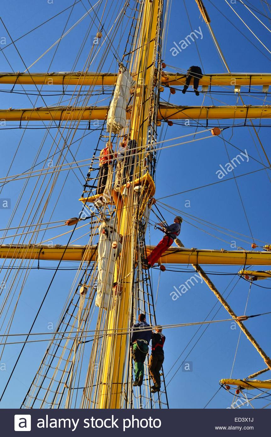 Detail ship masts workers port of Malaga Spain Europe - Stock Image