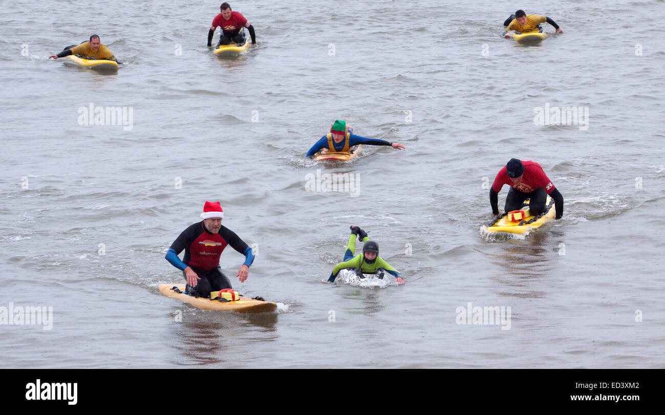 Sidmouth, Devon, UK. 26th December, 2014. Surfing Santas in the English Channel at Sidmouth, Devon, Boxing Day 2014. Stock Photo