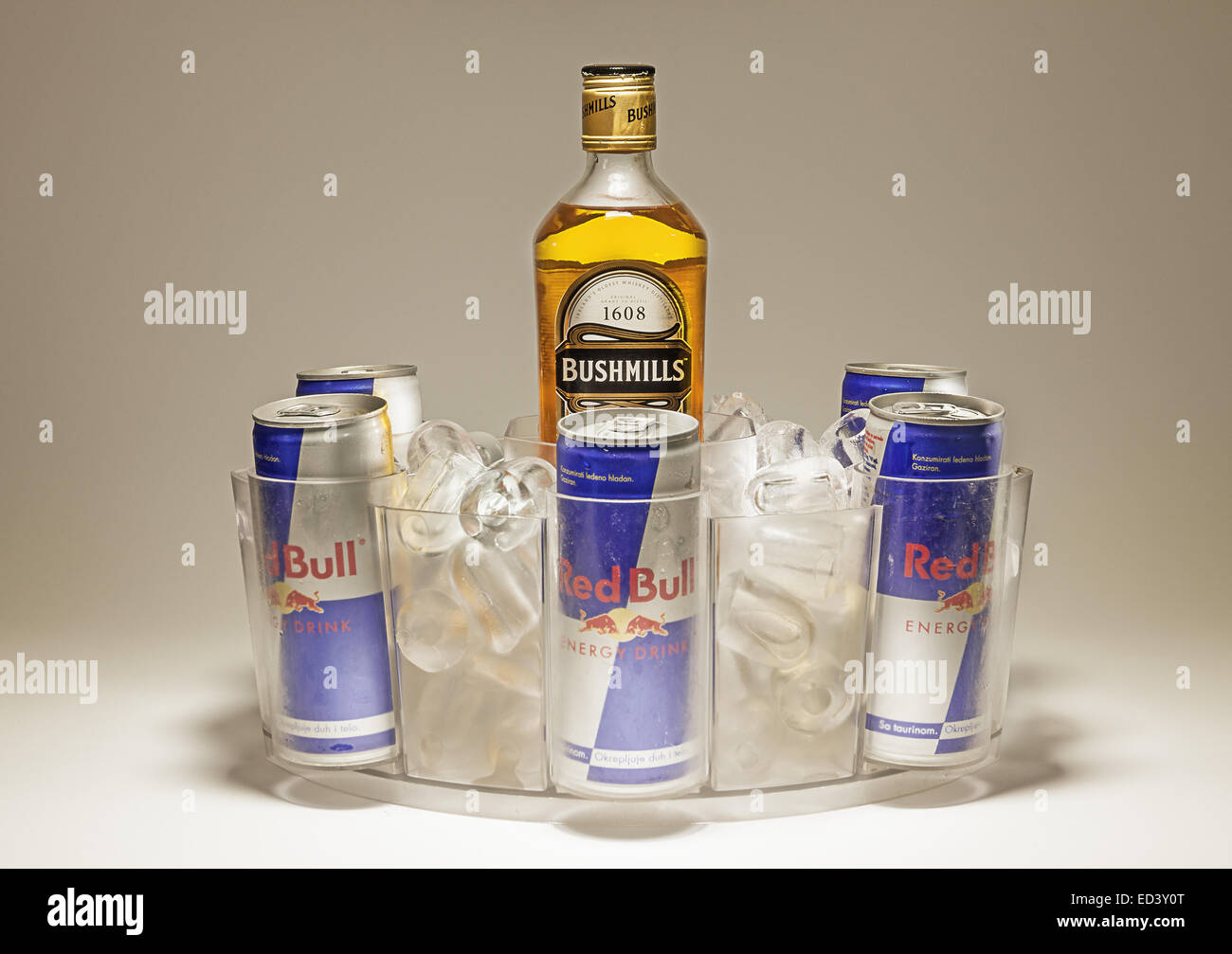 Cacak, Serbia - September 20, 2014: Bushmills and Red Bull cans served in special dish with ice. Stock Photo