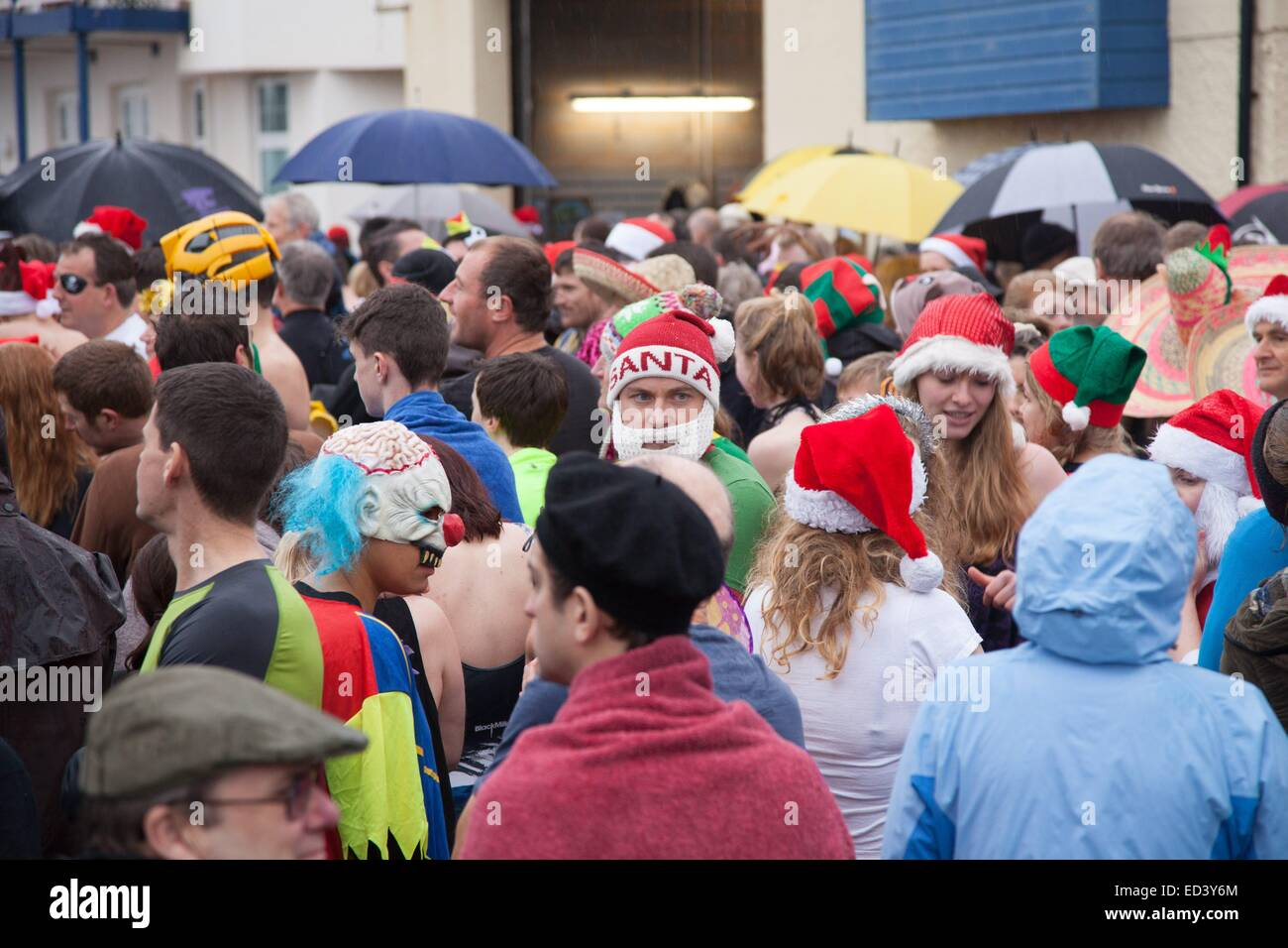 Sidmouth, Devon, UK. 26th December, 2014. Swimmers brave the freezing temperature of the English Channel at the - Stock Image
