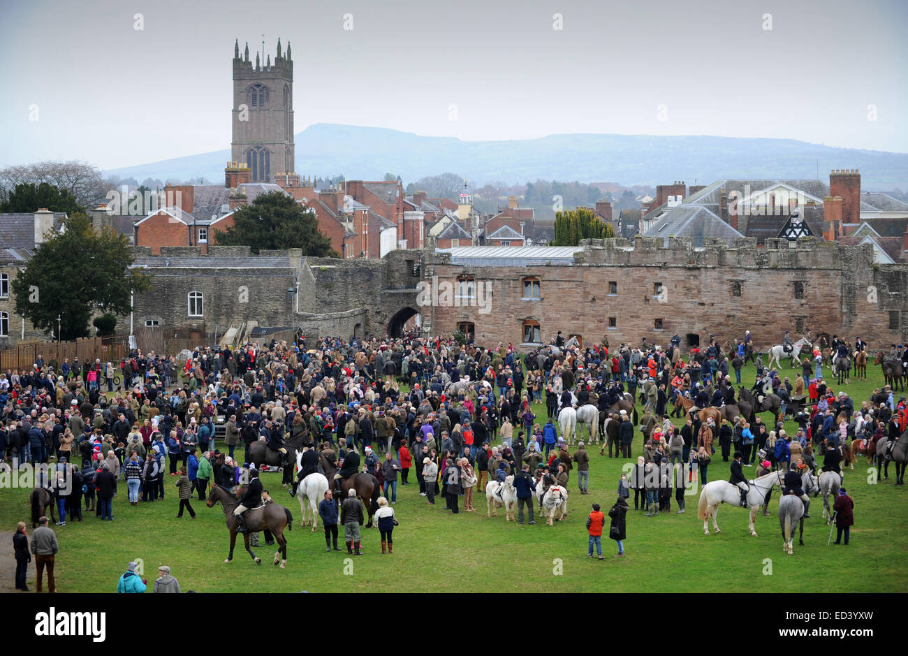 Riders and spectators gather for The Ludlow Hunt Boxing Day meet at Ludlow Castle - Stock Image
