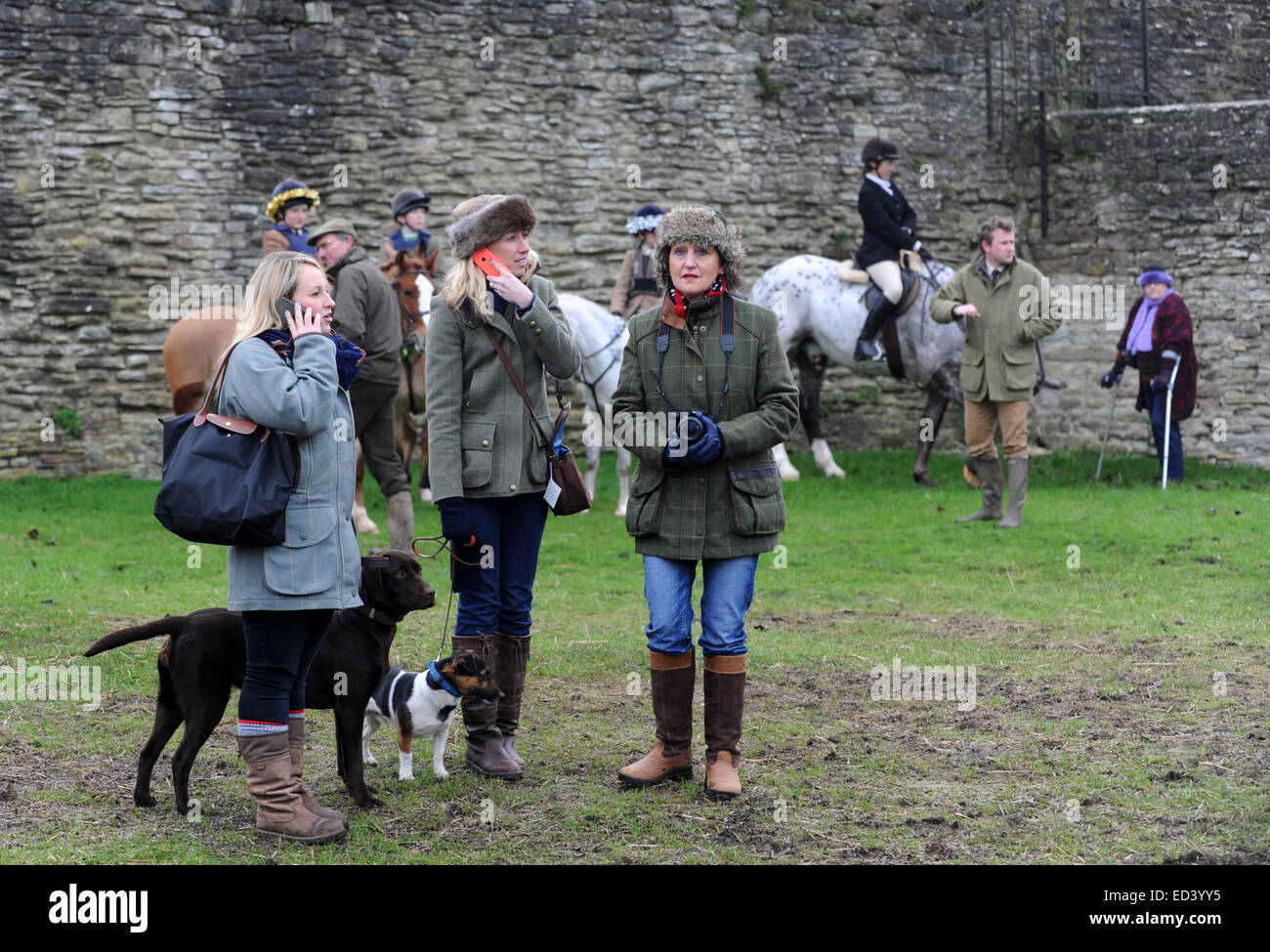 Spectators at The Ludlow Hunt Boxing Day meet at Ludlow Castle - Stock Image