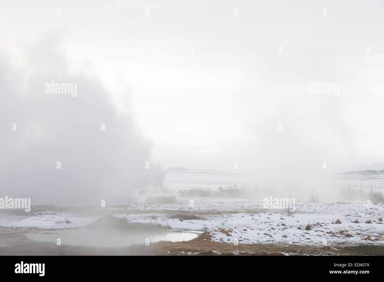 Steam rising from the ground at Haukadalur geothermal area, Iceland - Stock Image