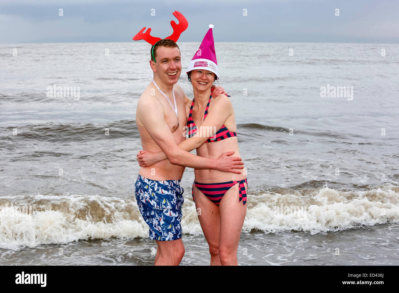 Prestwick, Scotland, UK. 26th Dec, 2014. The 9th annual clic sergent Boxing Day swim was held at Prestwick beach, - Stock Image