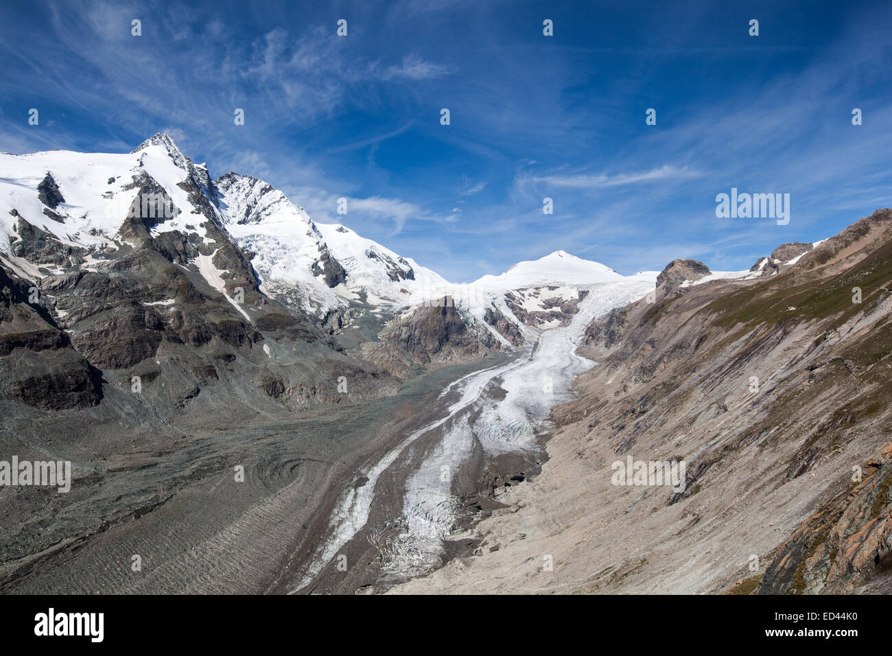Landscape with high mountain peaks and melting glacier. - Stock Image