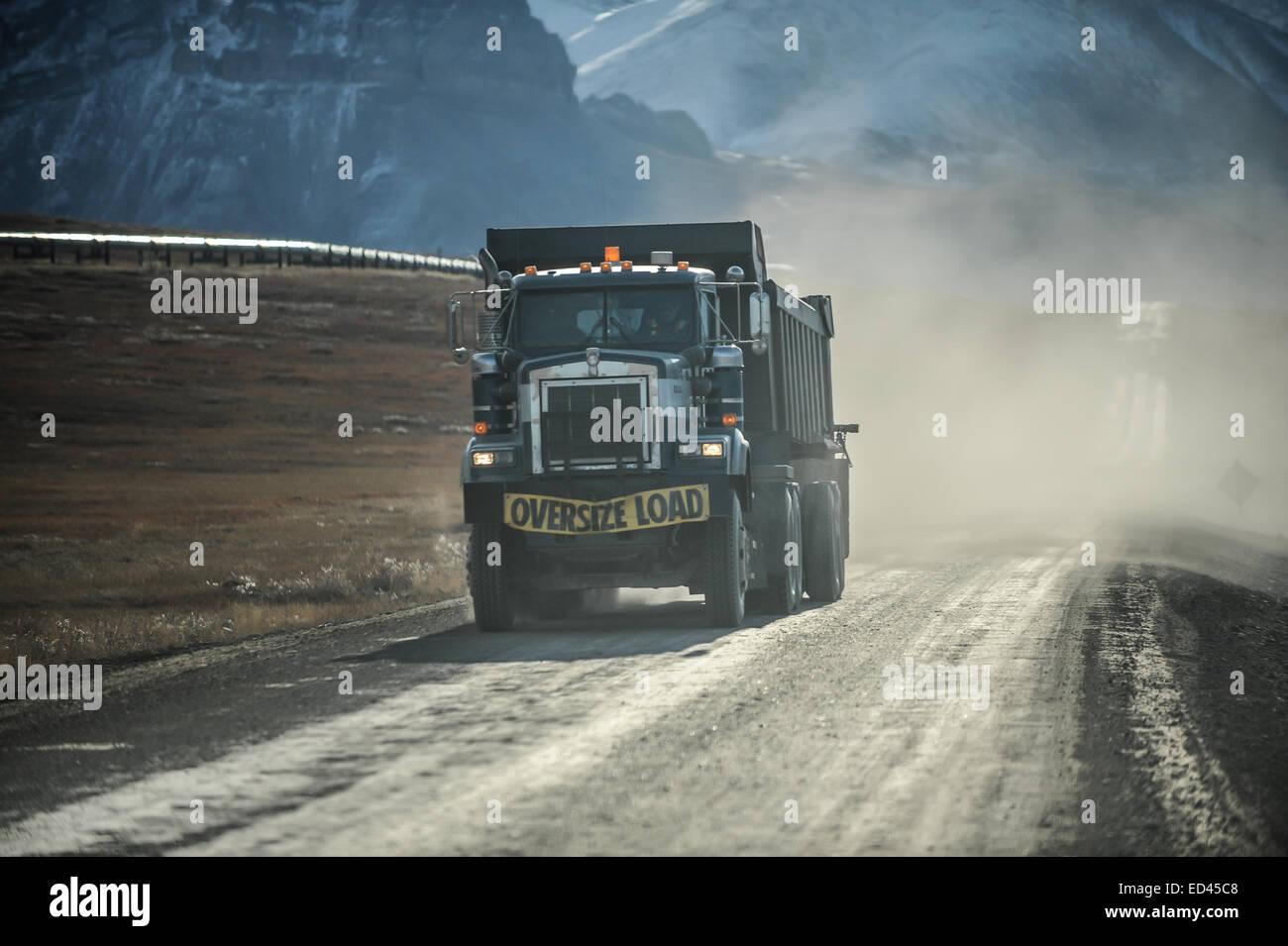 Eighteen wheeler truck with an oversize load sign, Alaska, US - Stock Image