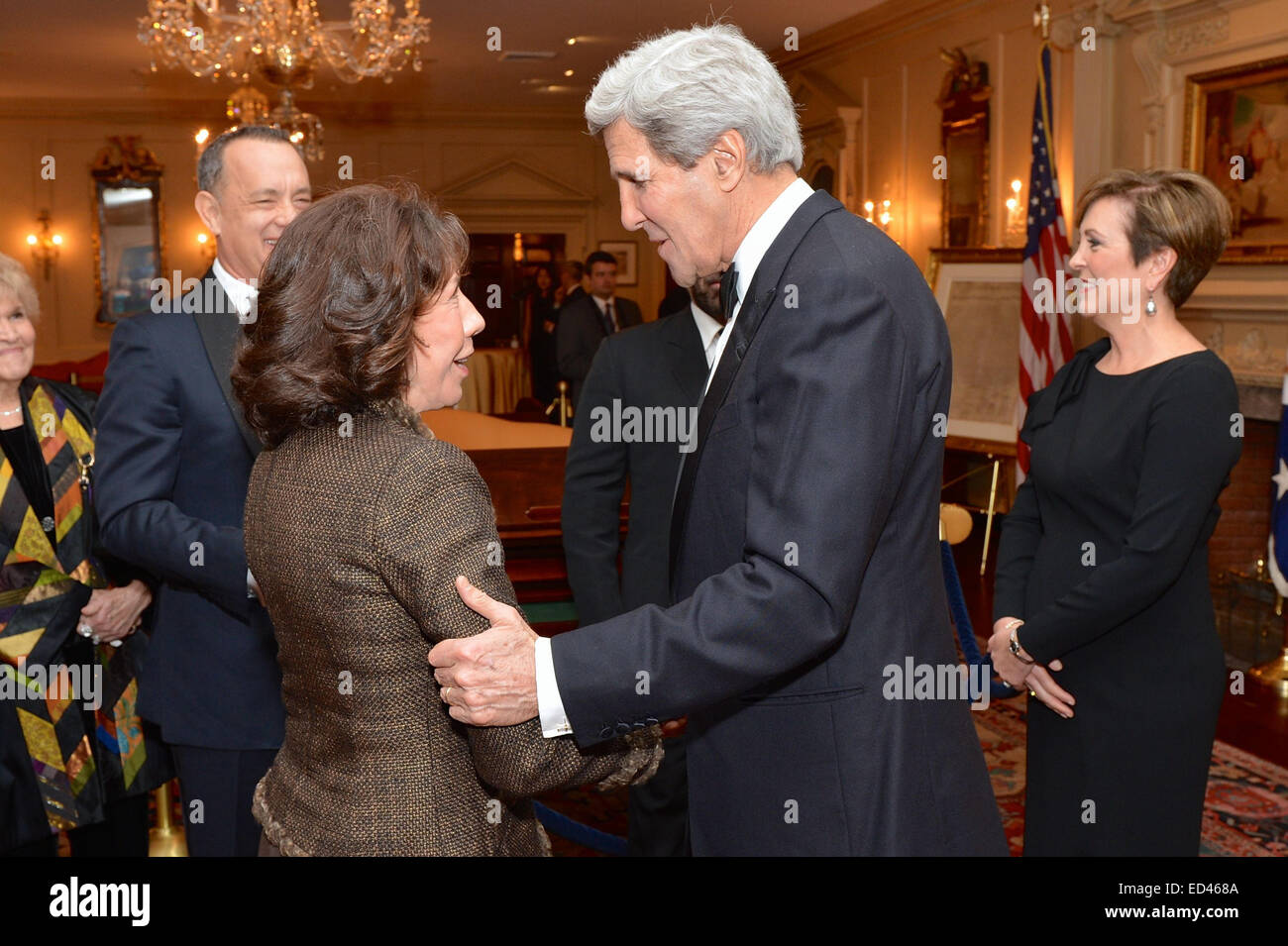 With 2014 Kennedy Center Honoree Tom Hanks looking on, U.S. Secretary of State John Kerry chats with fellow 2014 - Stock Image