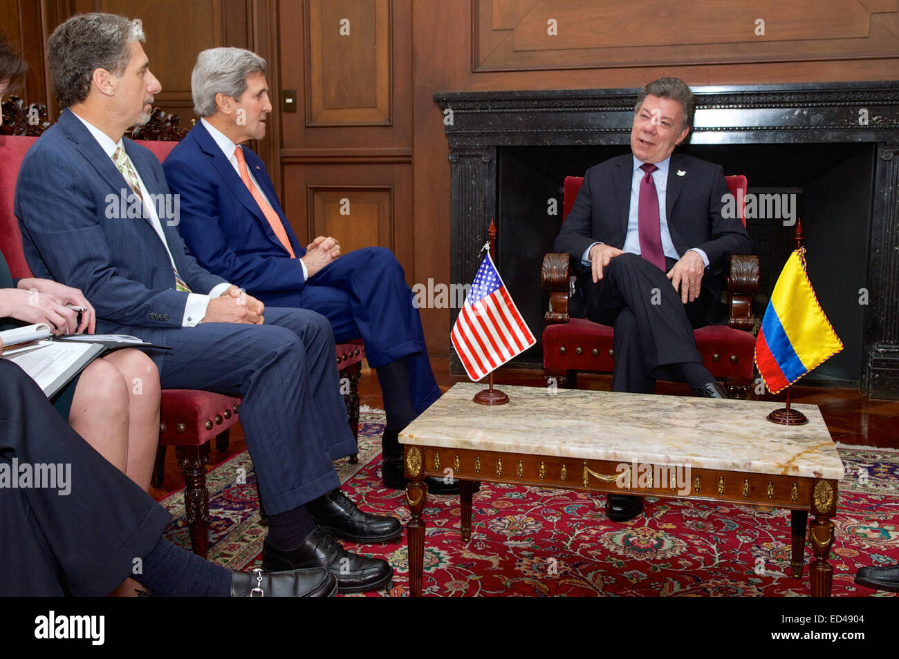 Colombian President Juan Manuel Santos chats with U S