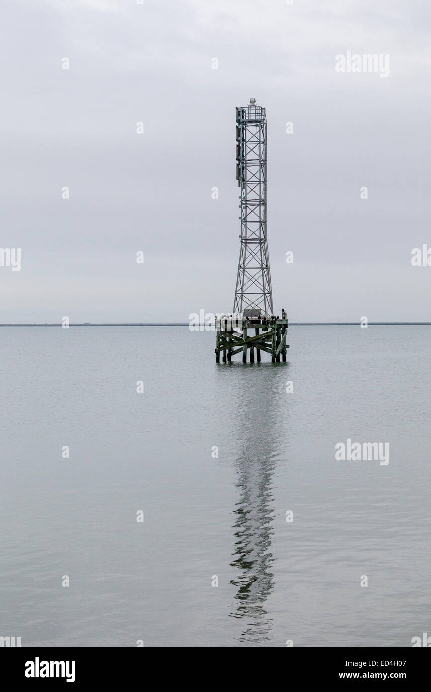 Fog horn and boating hazards warning tower at Texas City Dike. - Stock Image