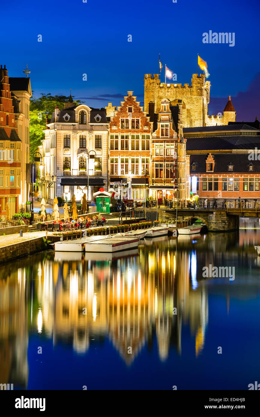 Ghent, Belgium. Graslei water channel with reflection Gravensteen Castle in night, Flanders - Stock Image