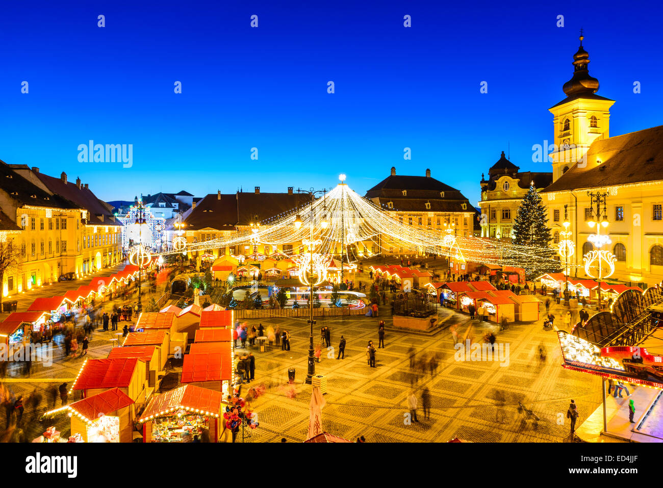 SIBIU, ROMANIA - 20 DECEMBER 2014: Night image with tourists at Christmas Market in Great Market of medieval Sibiu, - Stock Image