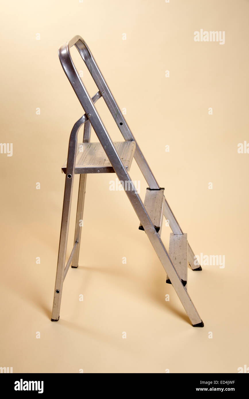 Small stepladder in the open position on a plain background Stock Photo