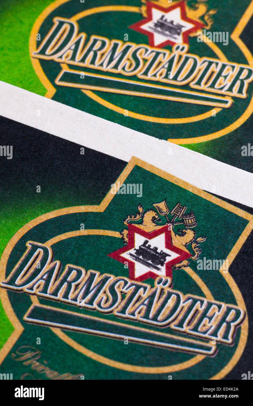 Berlin,Germany-December 12,2014:Beermats from Darmstadter beer.In 1847 Wilhelm and Jacob Rummel opend their first - Stock Image