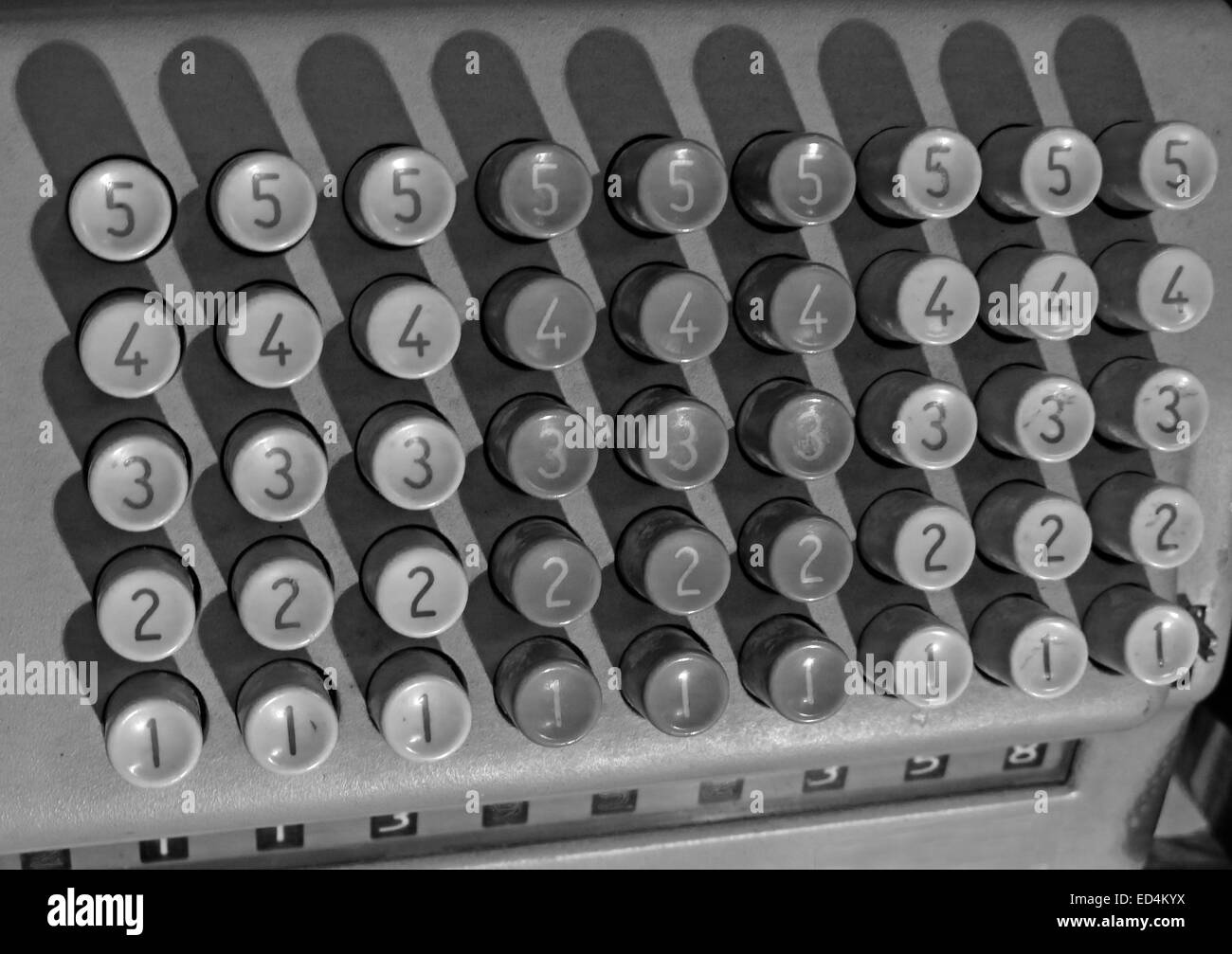 Comptometer - key-driven mechanical calculator showing numbered button keys in monochrome - Stock Image