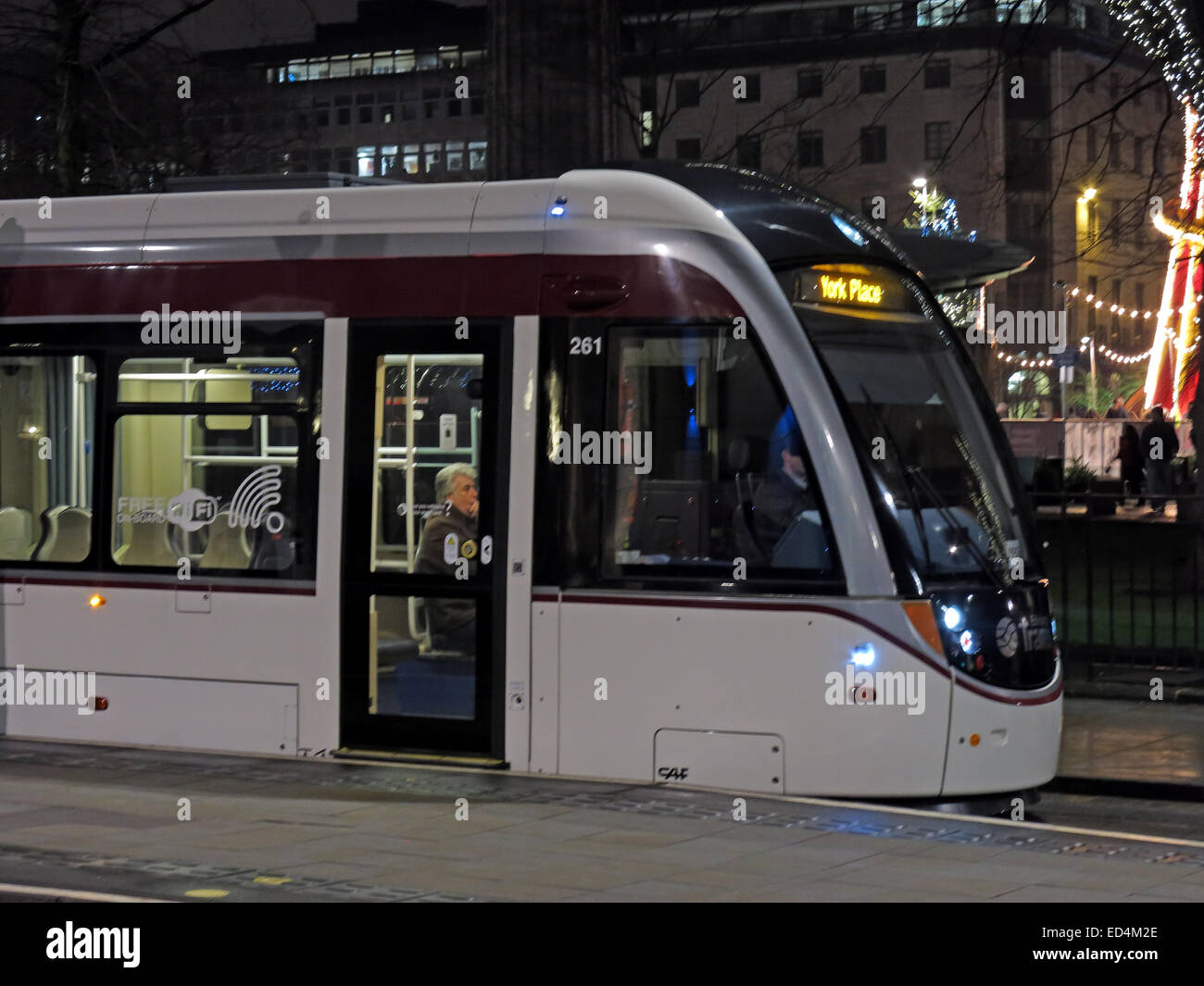 Front of New Edinburgh Tram bound for York Place, in St Andrew Square at night, Scotland, UK - Stock Image