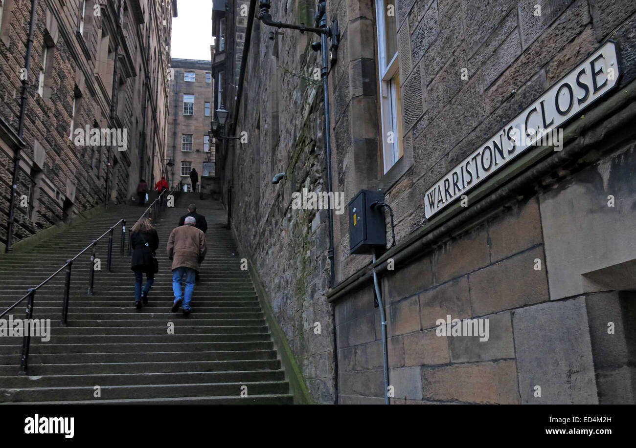 Steep steps up Warristons Close, Edinburgh,with two walkers, Scotland, UK - Stock Image