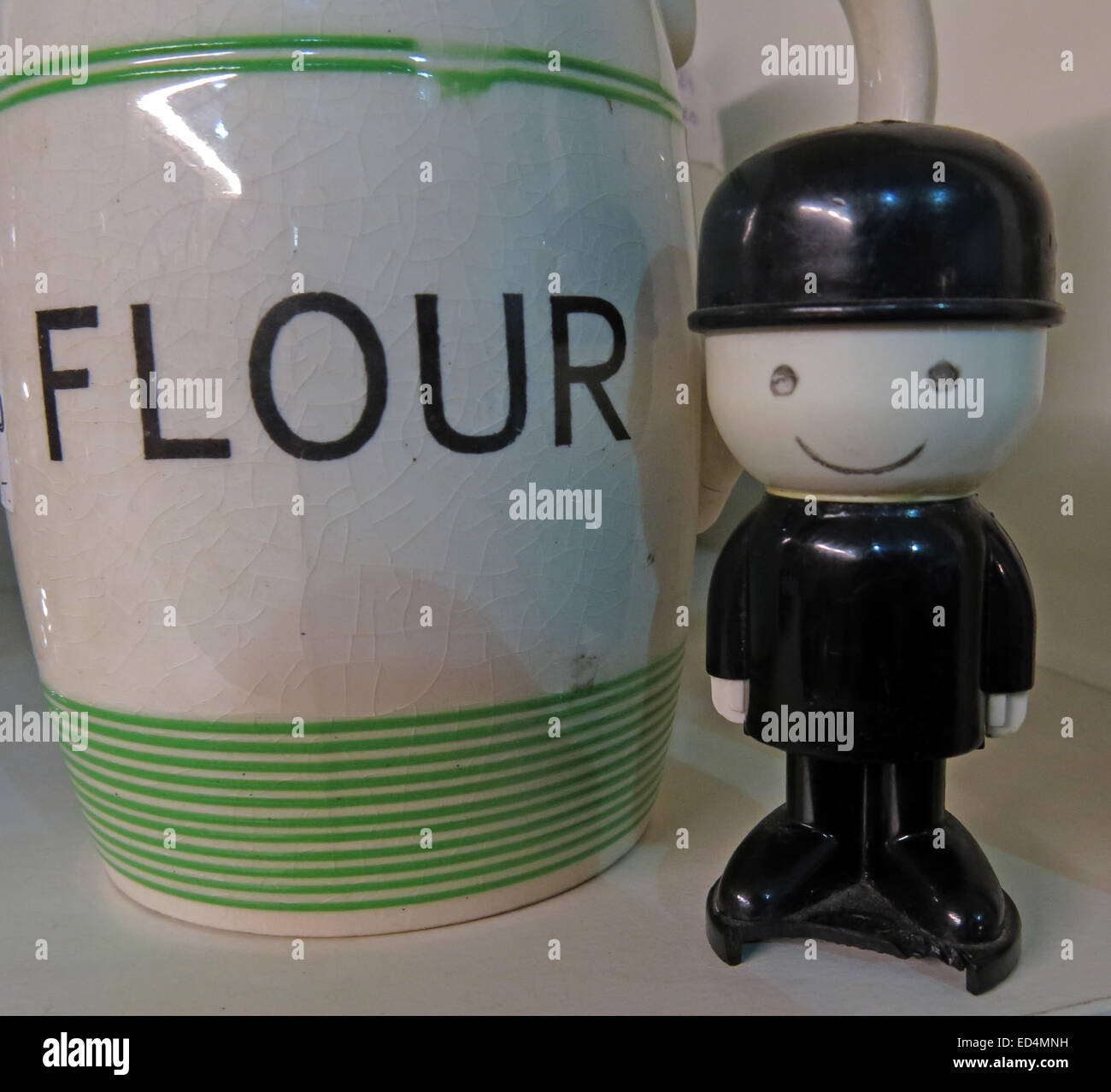 Henry or Fred the Homepride Spillers flour man, next to a floor jar - Stock Image