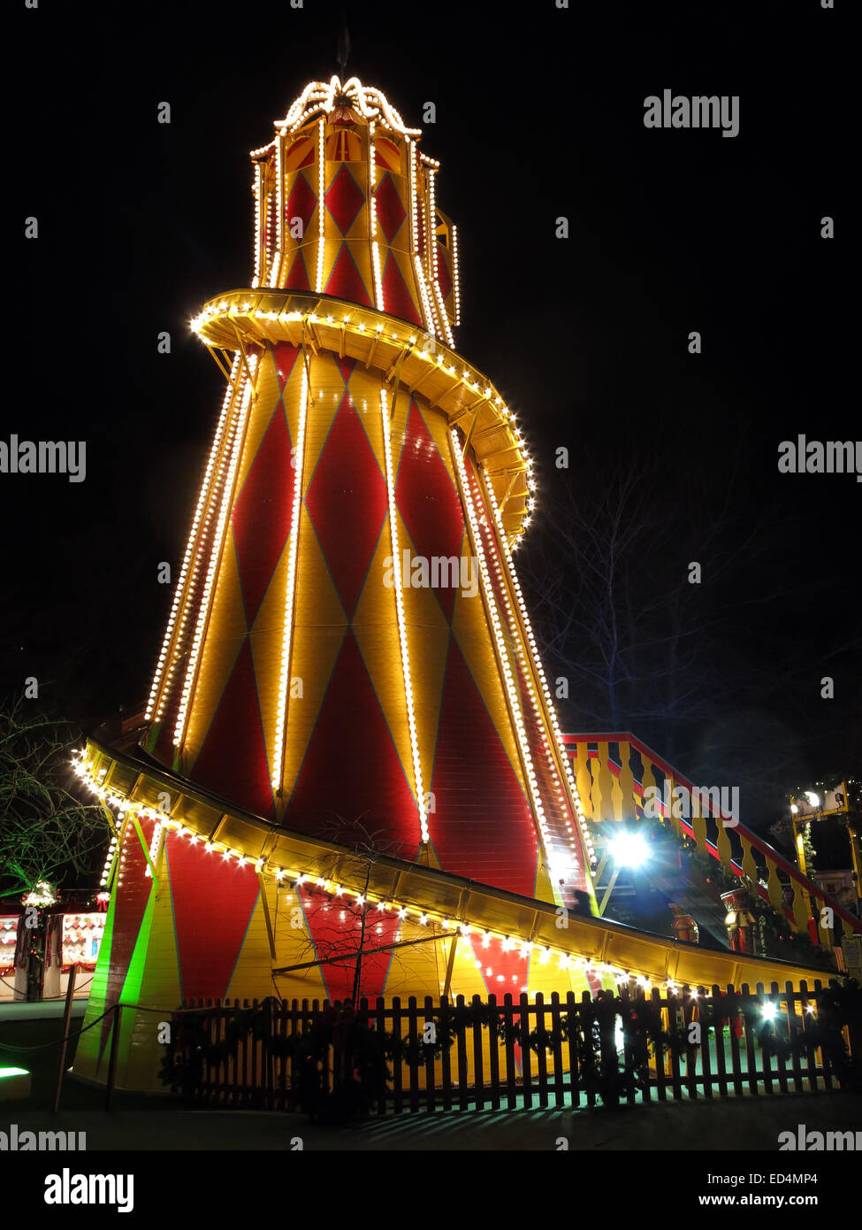Traditional fairground attractions, the big slide  at Night at Edinburgh's Hogmanay Stock Photo