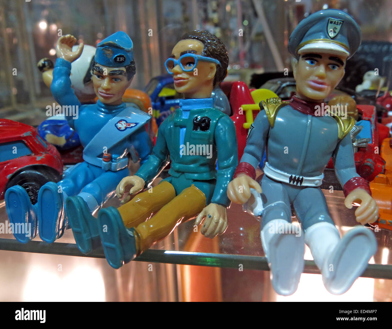 Plastic Thunderbird toy figures in  acabinet. Brains, Scott Tracy and Jeff. - Stock Image