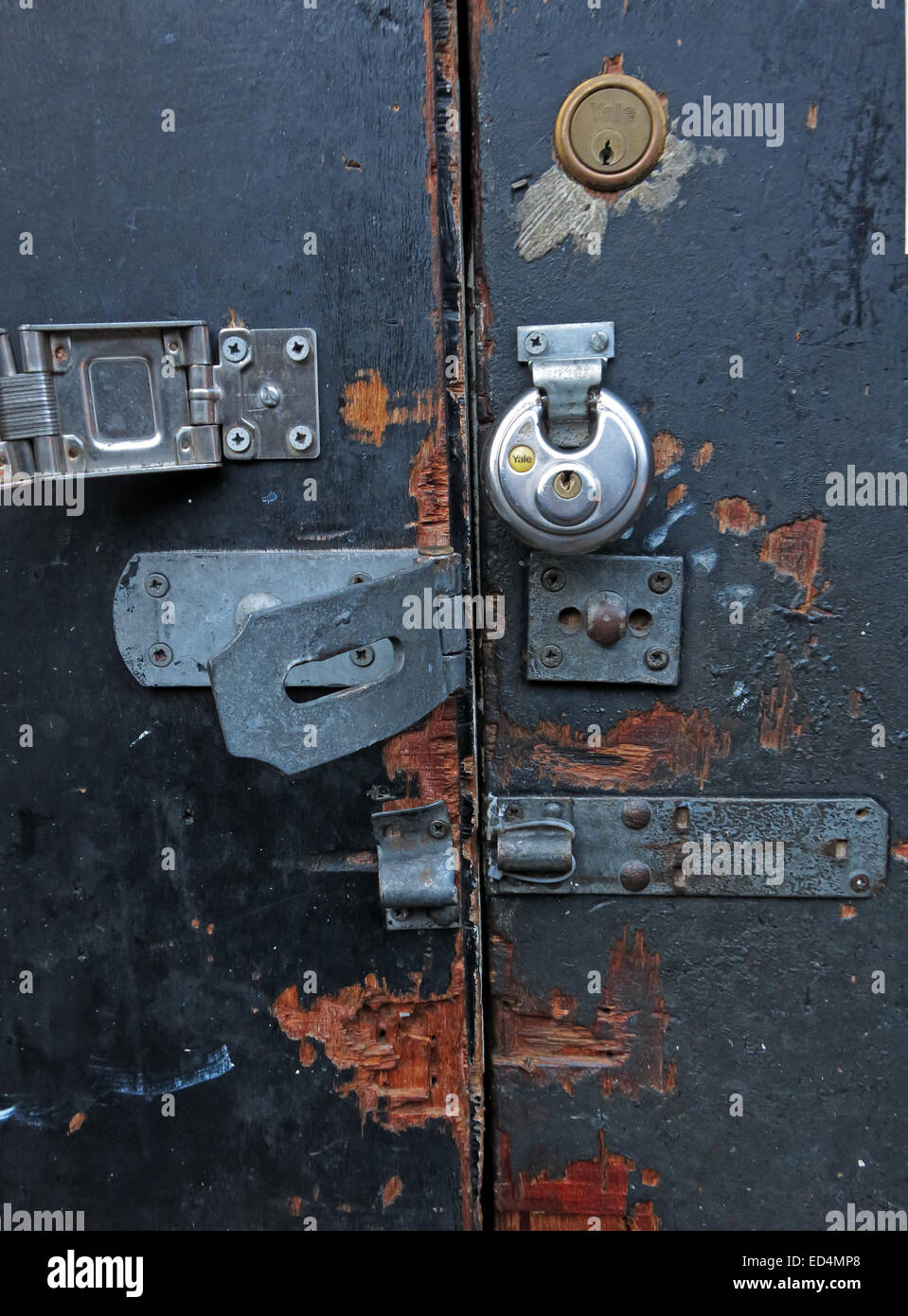 Ultra secure door with many locks, yale, padlock and bolts Stock Photo