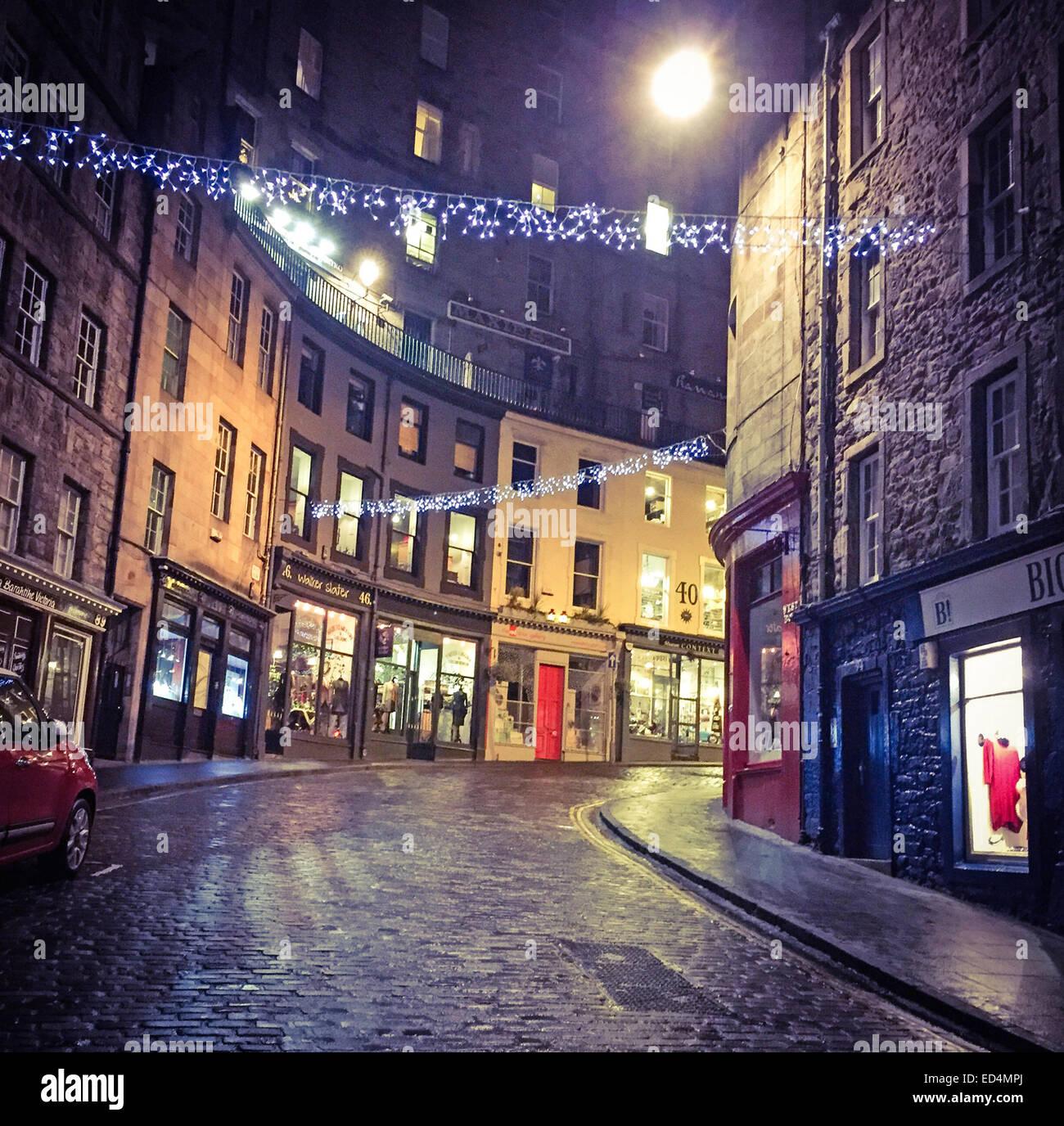 Looking up Edinburgh's Historic Victoria St, City Centre, Lothian, Scotland, UK at night - Stock Image