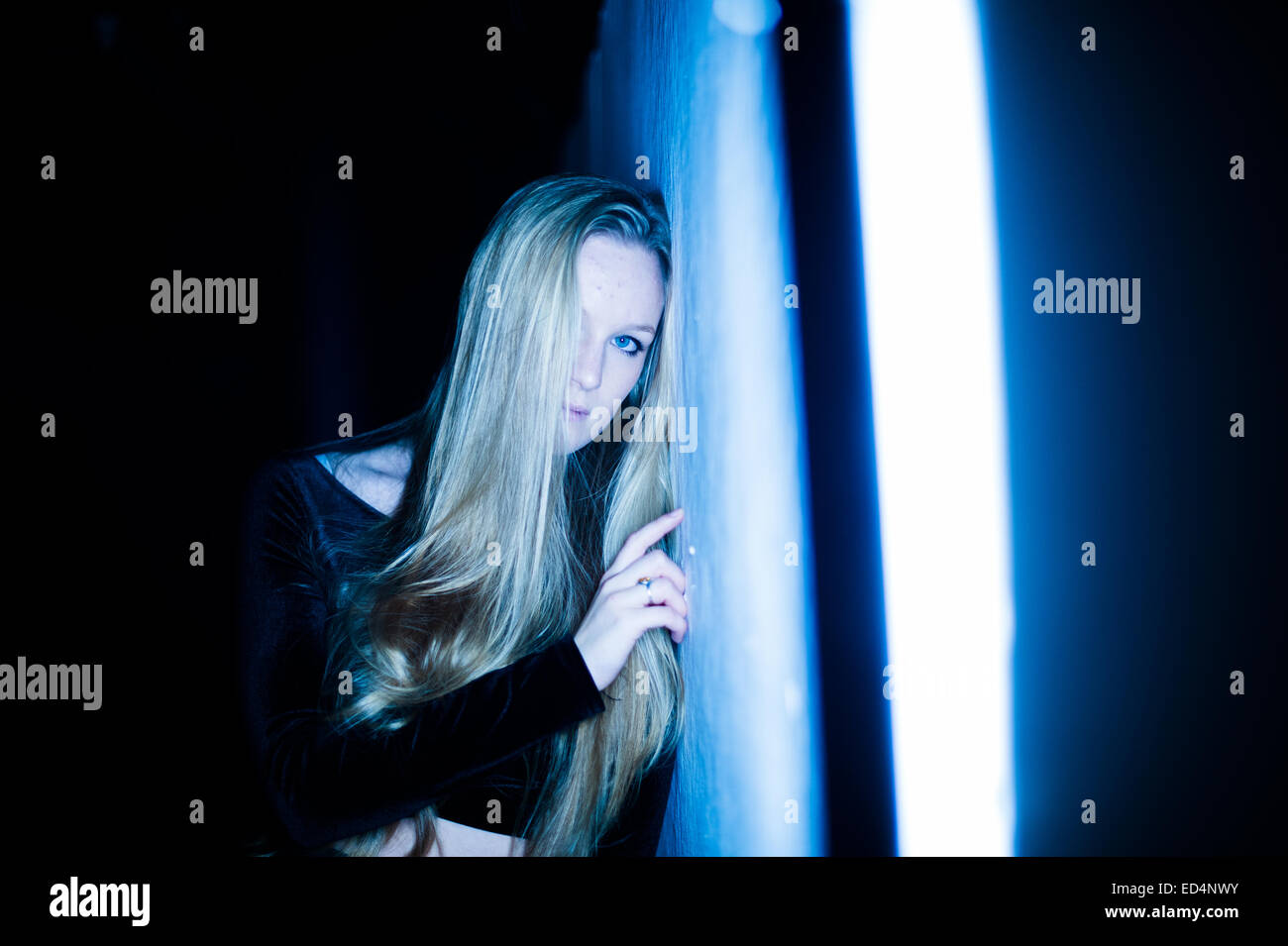blue: a young woman (18 year old girl) with long blonde hair, solo