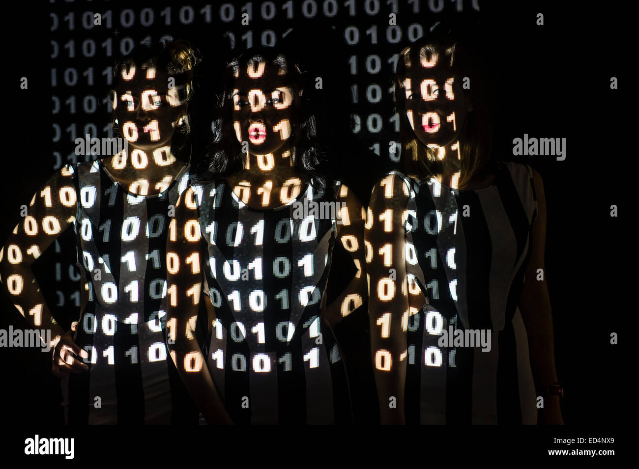 Digital Art: Conceptual image for cyber terrorism or cybercrime cyber crime - a group of 3 three young women girls - Stock Image