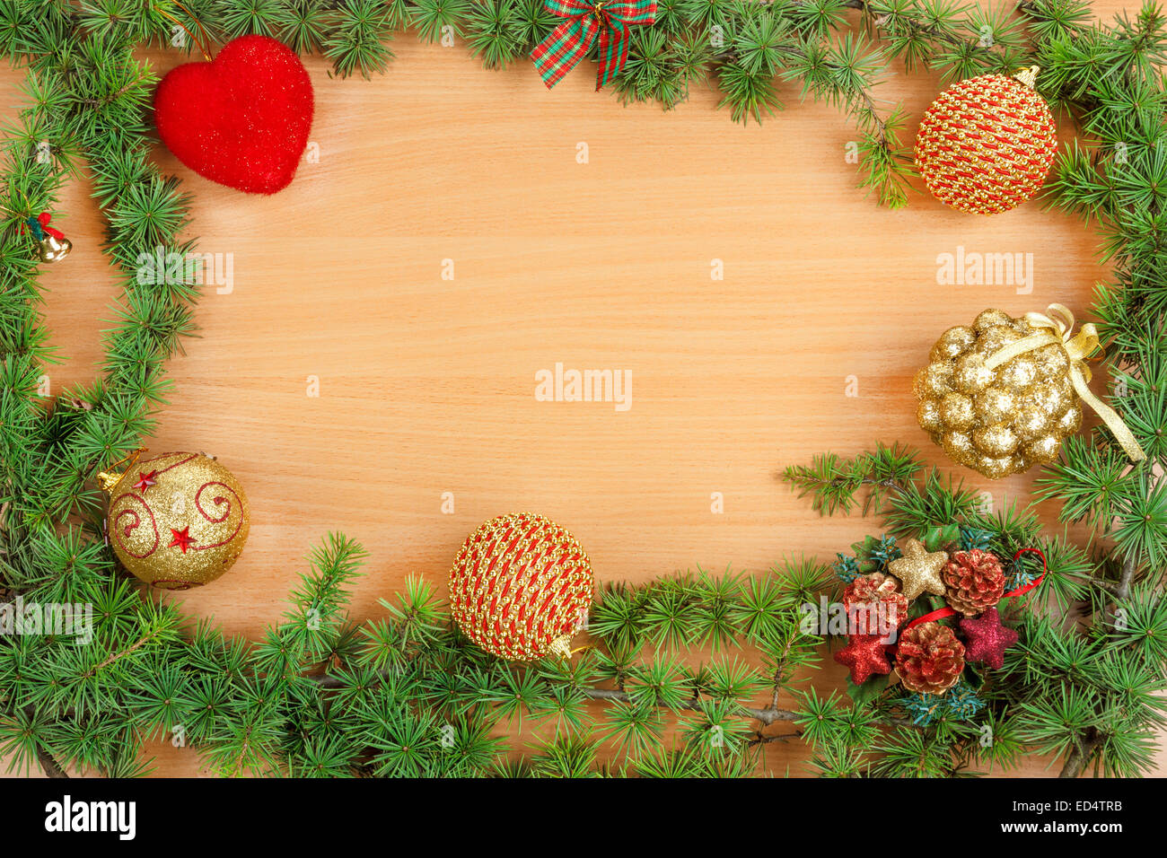 Christmas decoration with fir tree  and ornamentals on wood board with copyspace - Stock Image