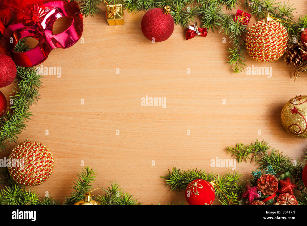 Christmas decoration with fir tree and glamor mask masquerade for party and celebration and ornamentals gifts on - Stock Image