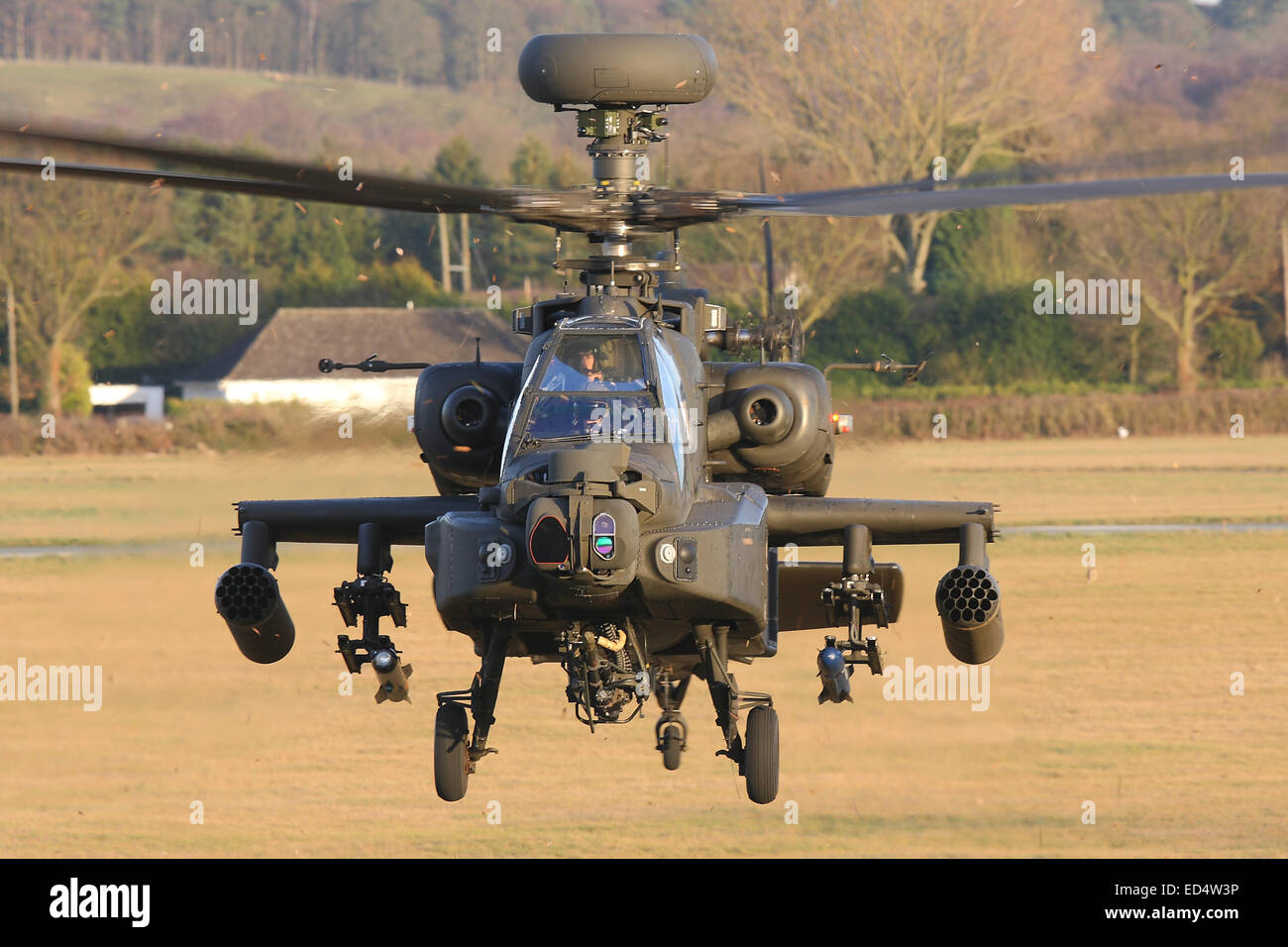 Menacing head on view of British Army Air Corps AAC Agusta Westland Ah-64D Apache attack helicopter in the hover - Stock Image