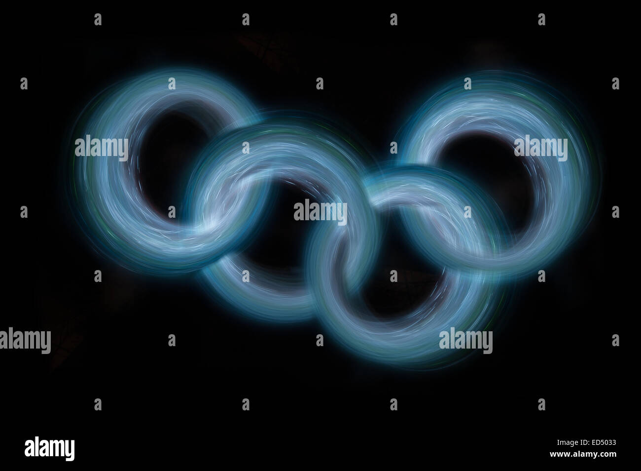 swirling spinning motion and trails traces of moving lights creating patterns vortice joined light rings circle - Stock Image