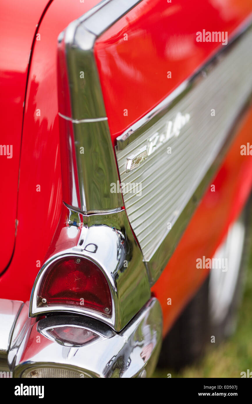 Rear light and panel on a restored red and silver vintage classic American car taken at a rally.  Taken in vertical - Stock Image