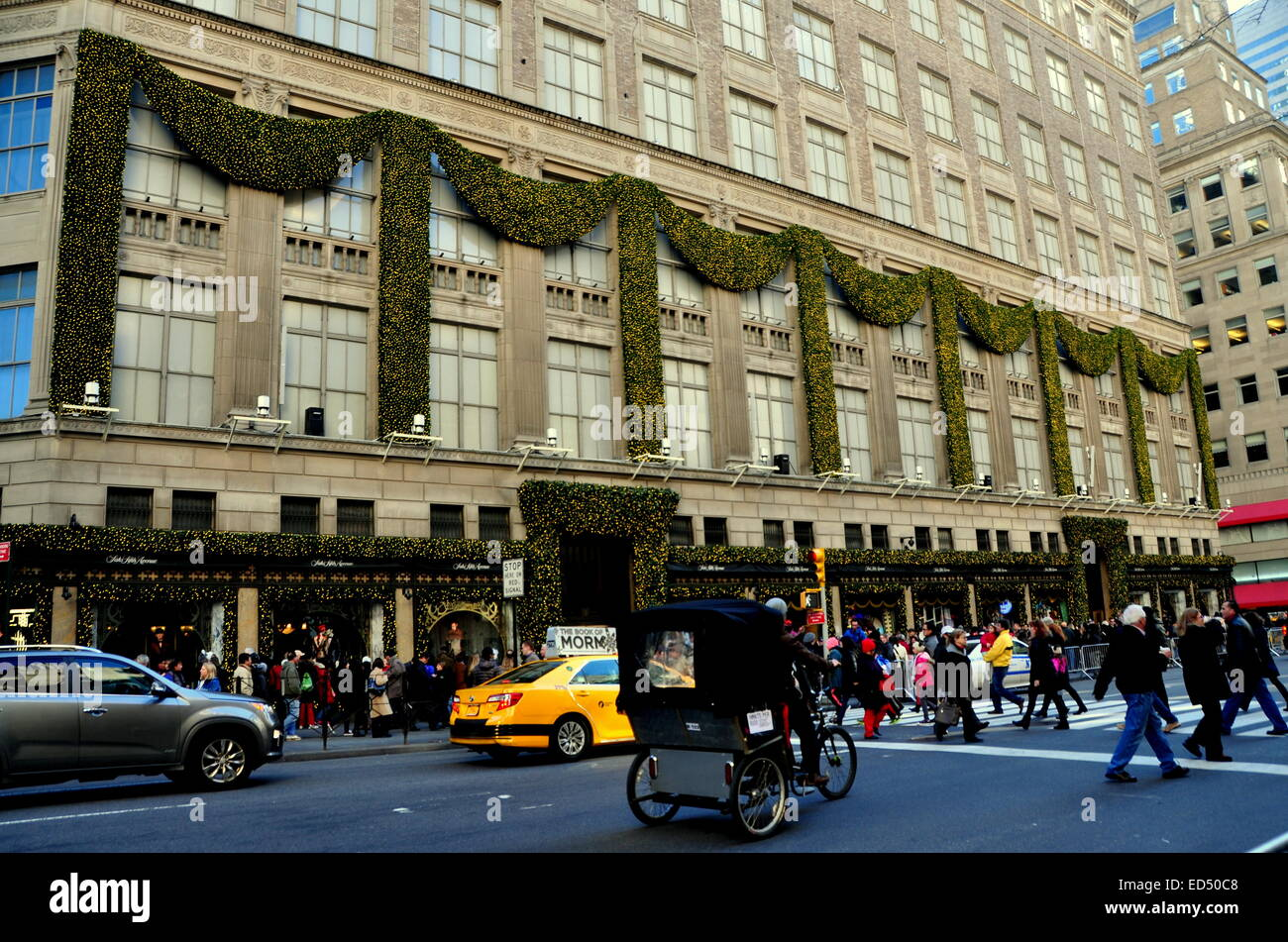 New York City: A Pedicab Taxi Passes Legendary Saks Fifth Avenue Department  Store Adorned WIth Christmas Decorations