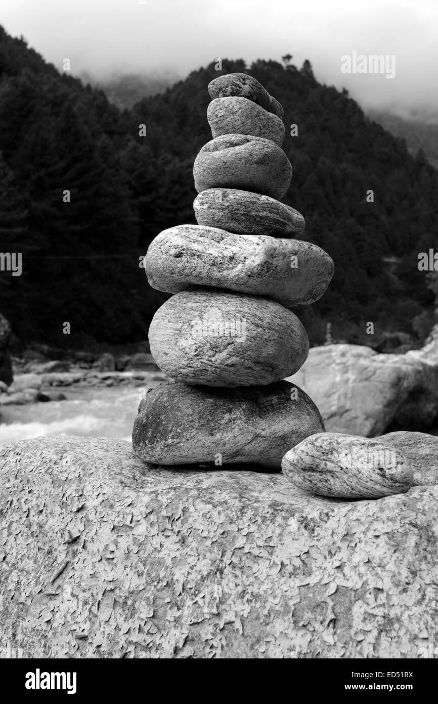 Buddhist Prayer Stones by the side of the Dudh Koshi river, Phakding village, Sagarmatha National Park, Solukhumbu Stock Photo