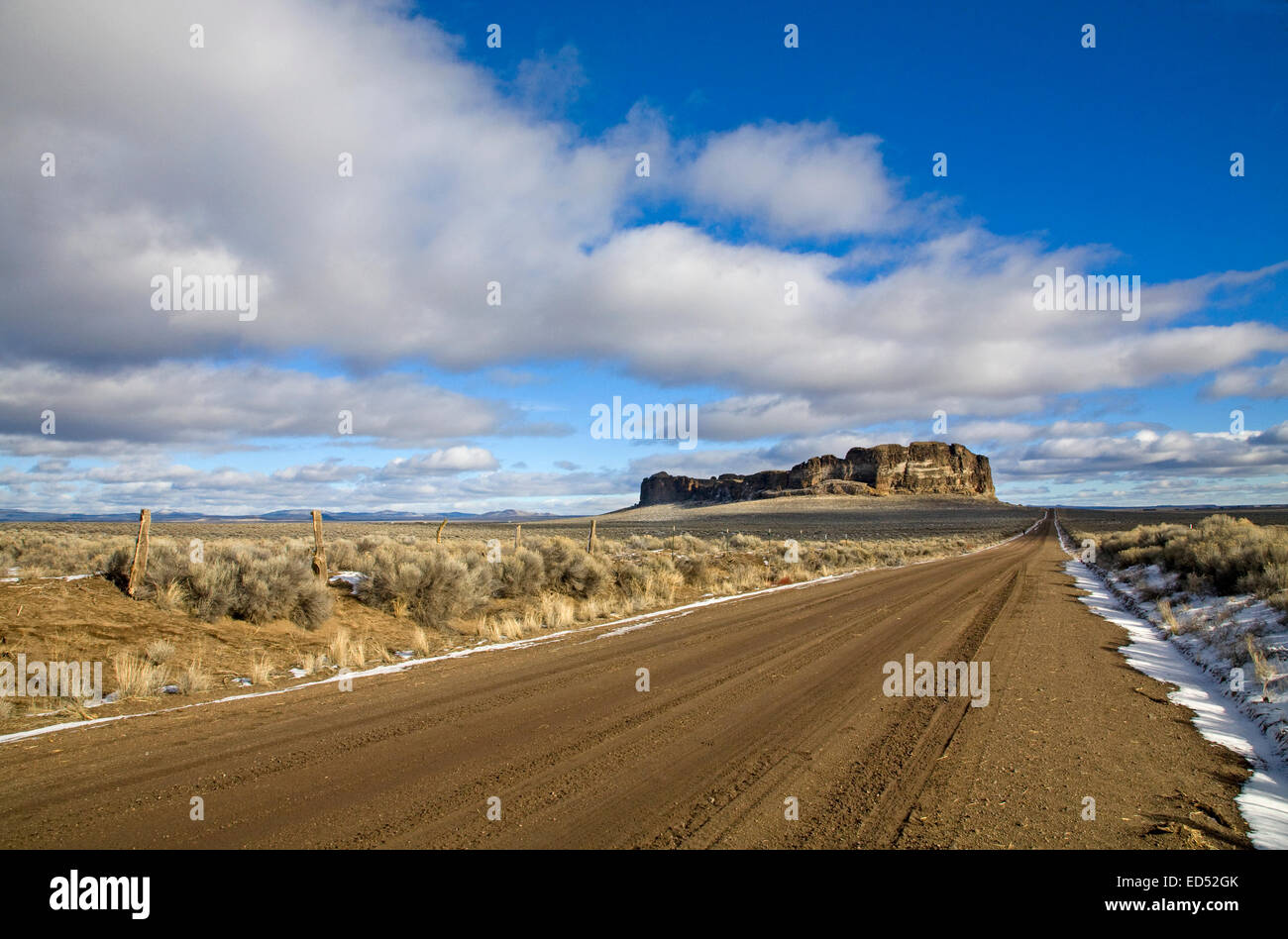 A lonely road at Fort Rock Natural Area, is a volcanic uplift in the high desert of the Oregon Outback, central - Stock Image