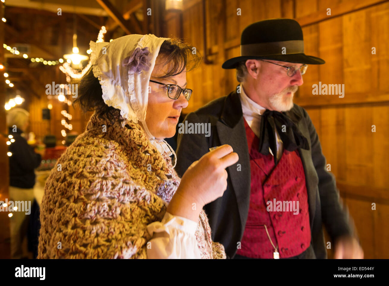 Old Bethpage, New York, USA. December 26, 2014. SHERRI GUTHRIE and husband CHART GUTHRIE, dressed in traditional - Stock Image
