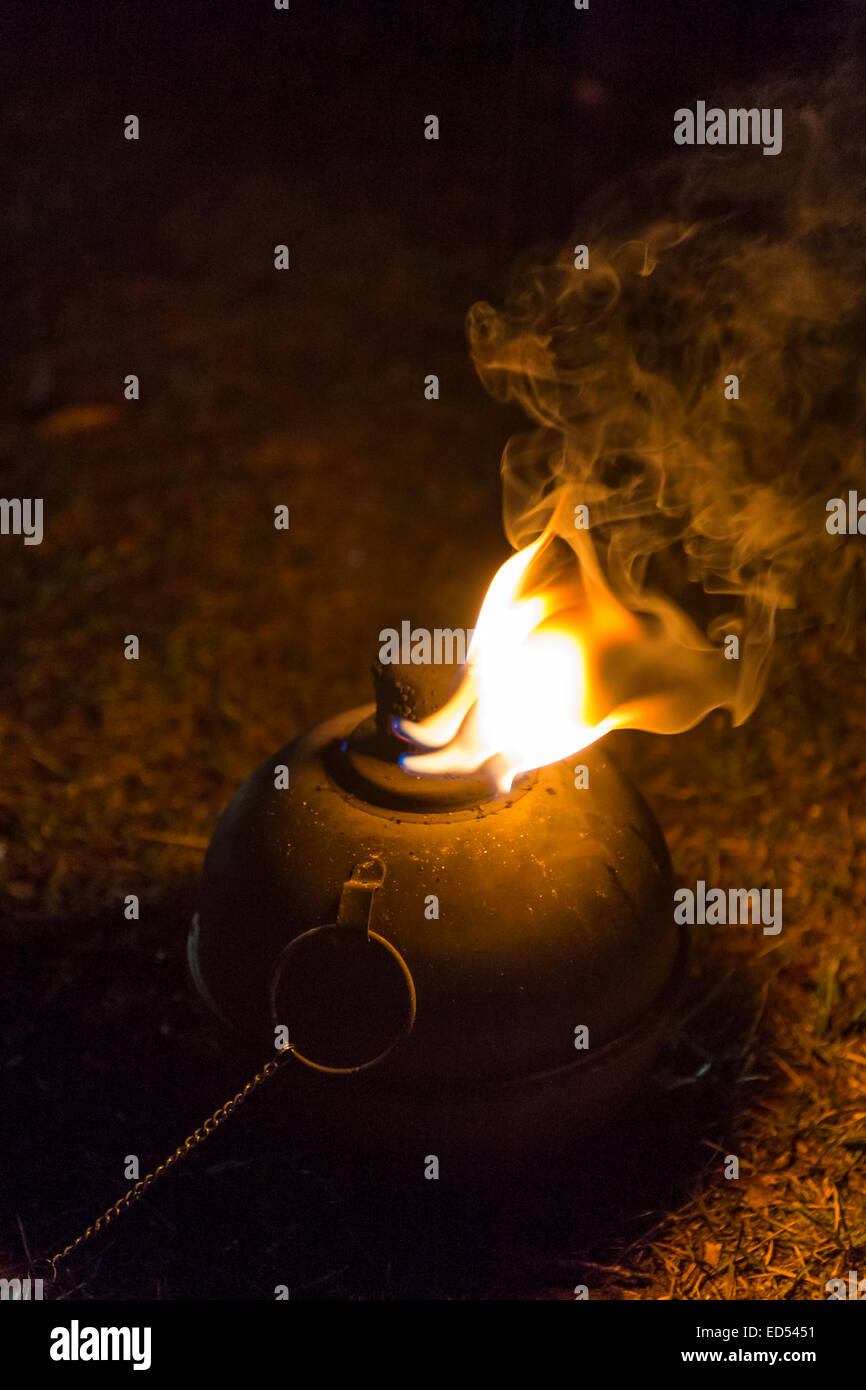 Old Bethpage, New York, USA. December 26, 2014. Paths are lit by antique kerosene smudge pots, road torches at night, - Stock Image