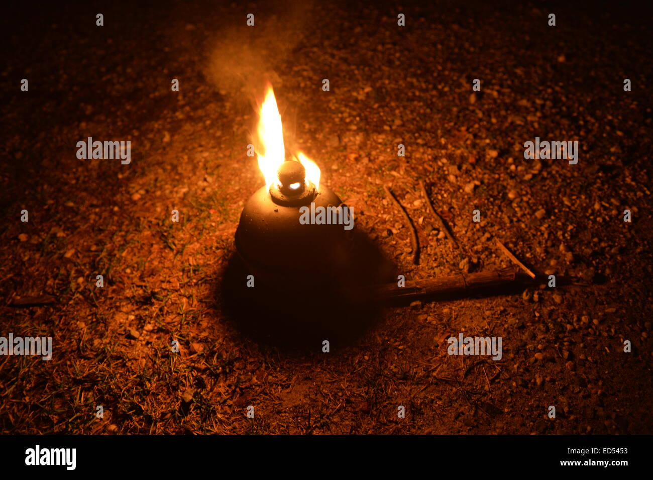 Old Bethpage, New York, USA. December 26, 2014. Paths are lit by antique kerosene smudge pots, road torches, at - Stock Image