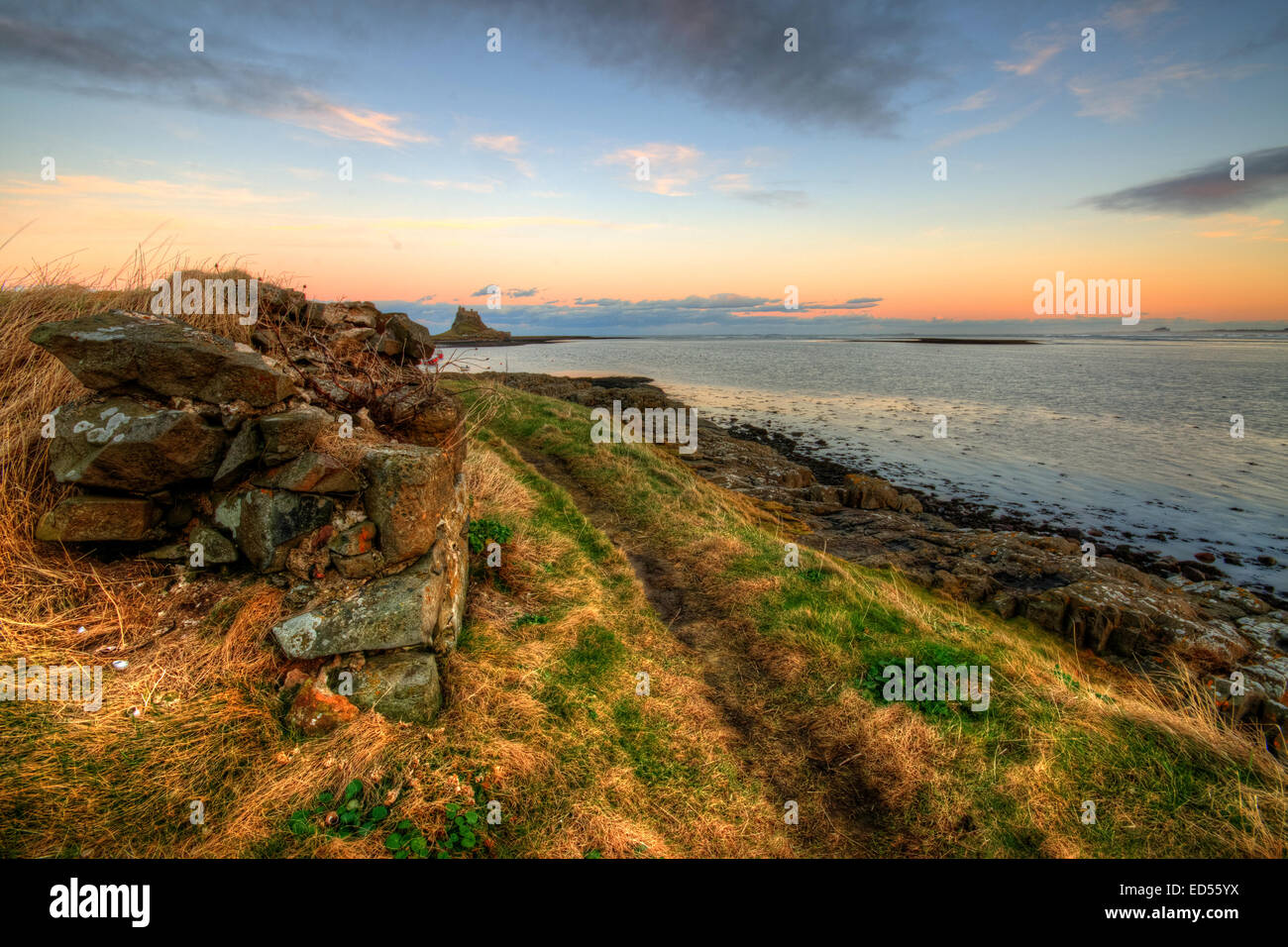 The views to Lindisfarne Castle at dusk on the Northumberland coast. Stock Photo