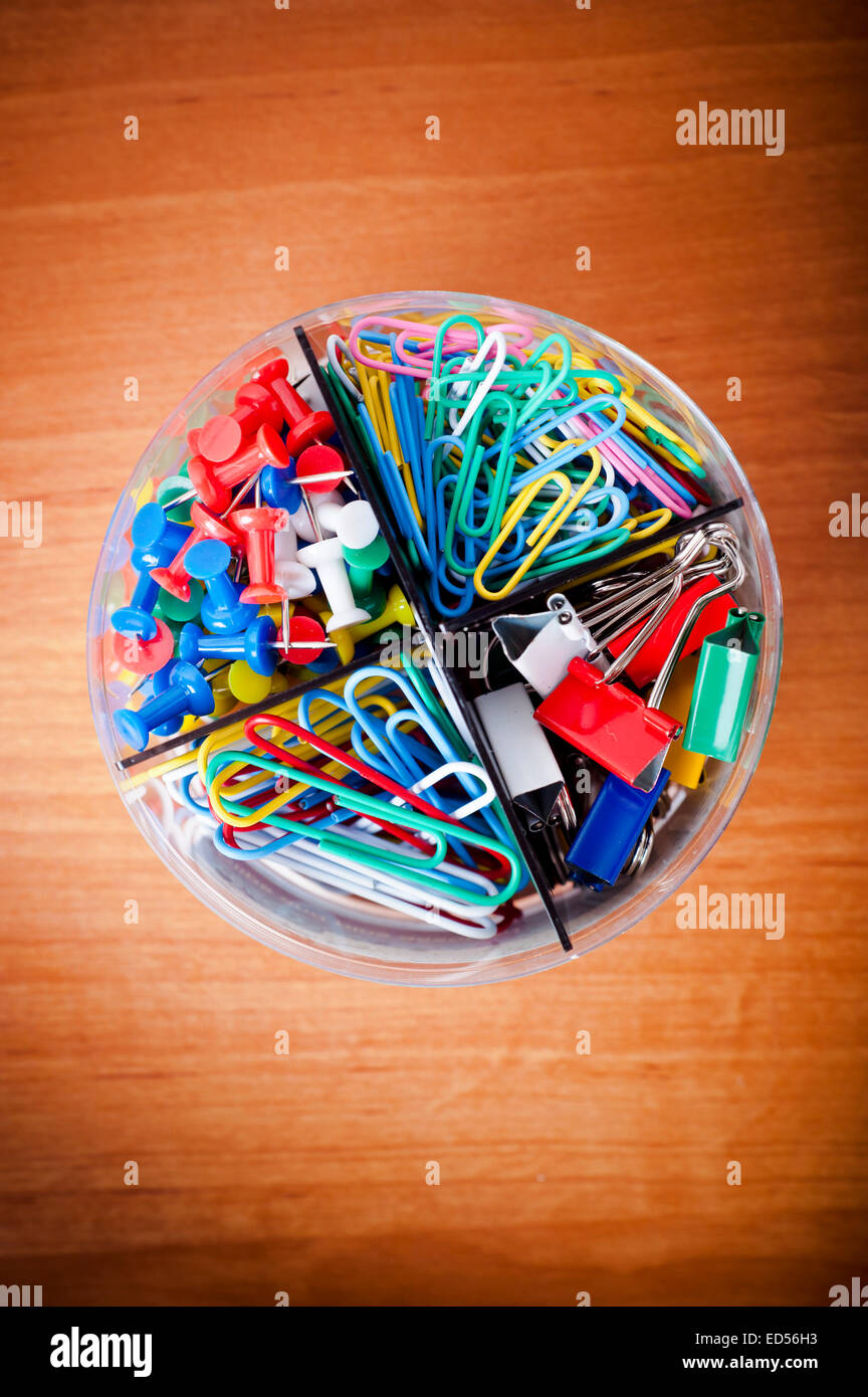 box with colorful office pins and clips - Stock Image
