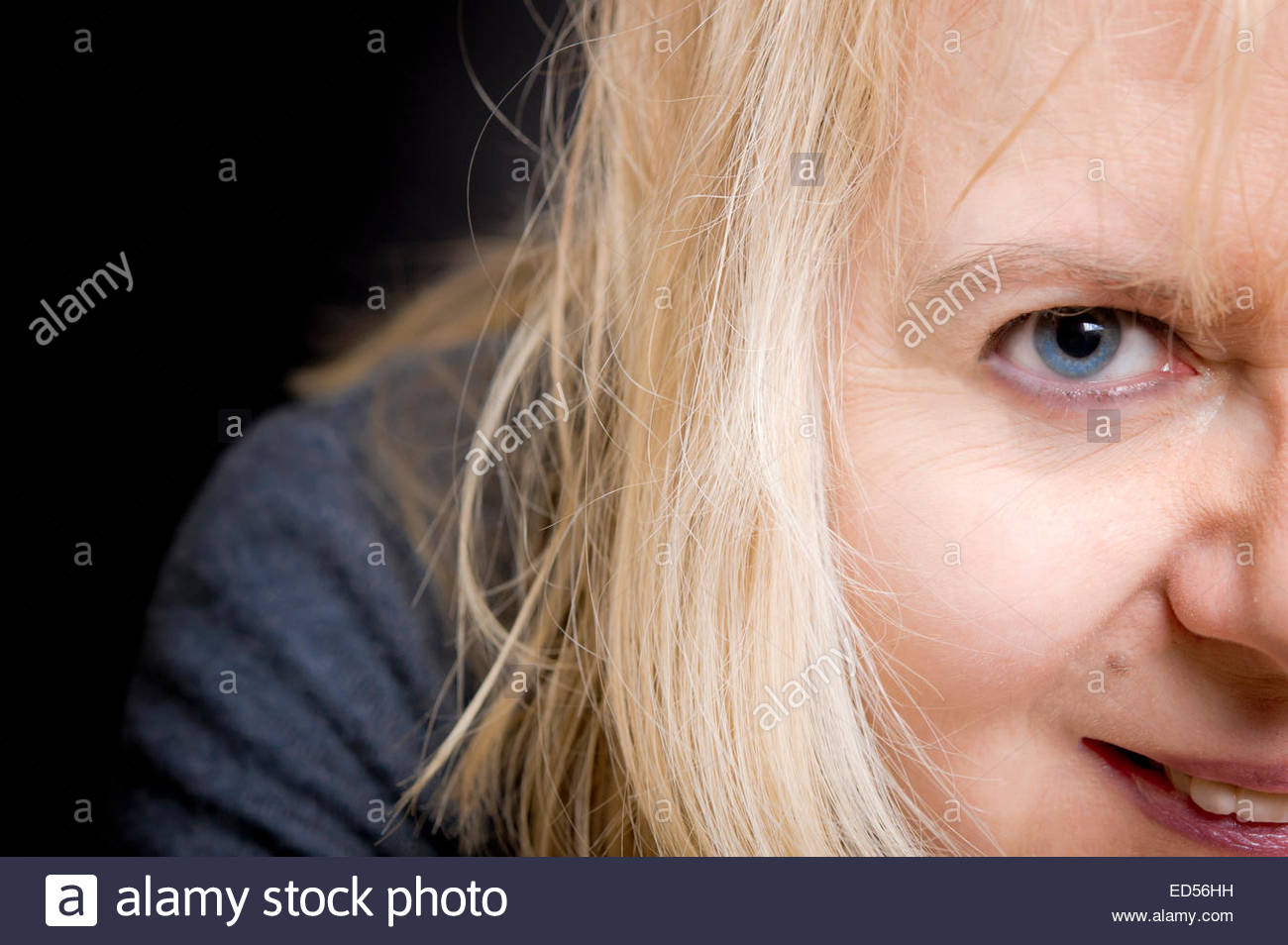portrait of a blond woman in her forties, happy and satisfied - Stock Image