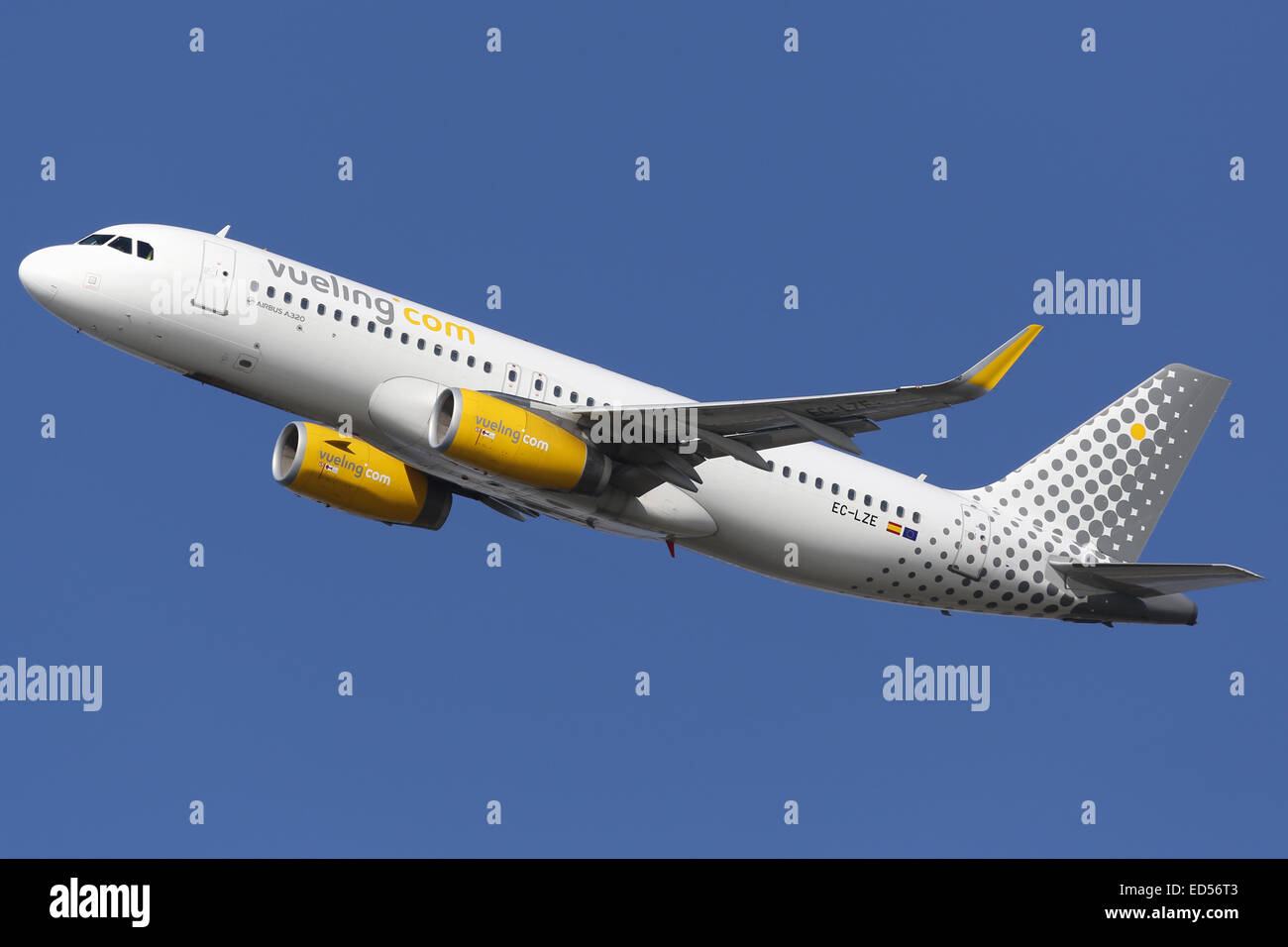 Barcelona, Spain - December 12, 2014: A Vueling Airbus A320 with the registration EC-LZE taking off from Barcelona - Stock Image