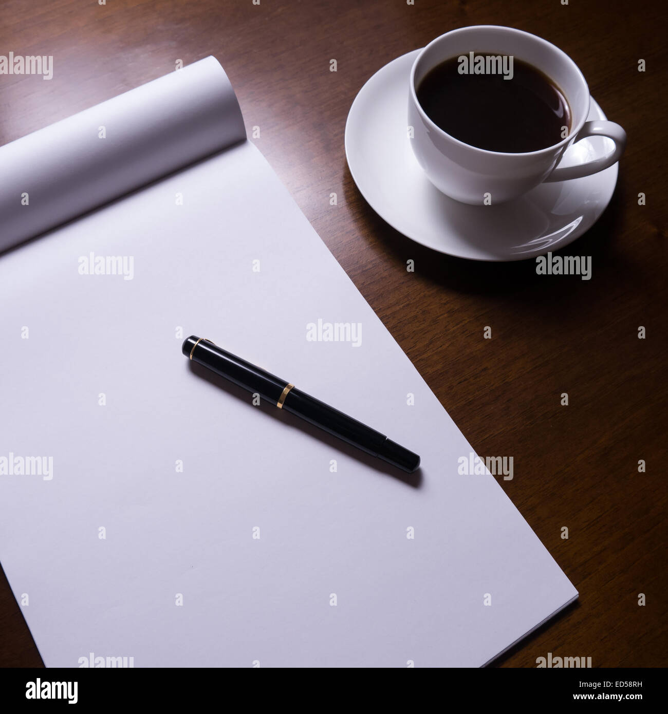 desk with fountain pen, sheet of paper, cup of coffee - Stock Image