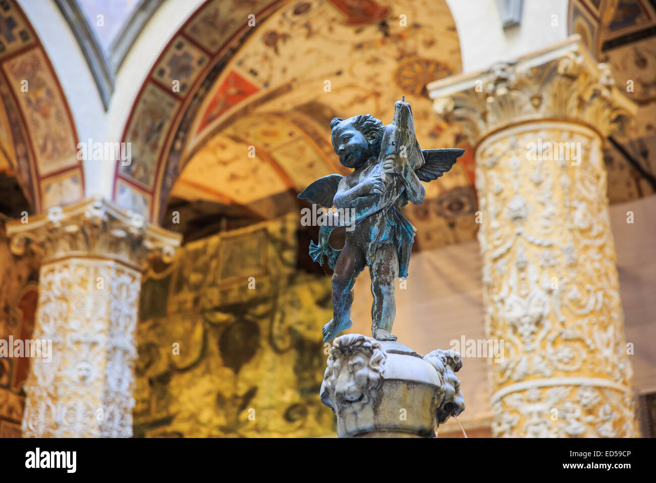 Statue of Putto with Dolphin, Palazzo Vecchio. Florence, Italy - Stock Image
