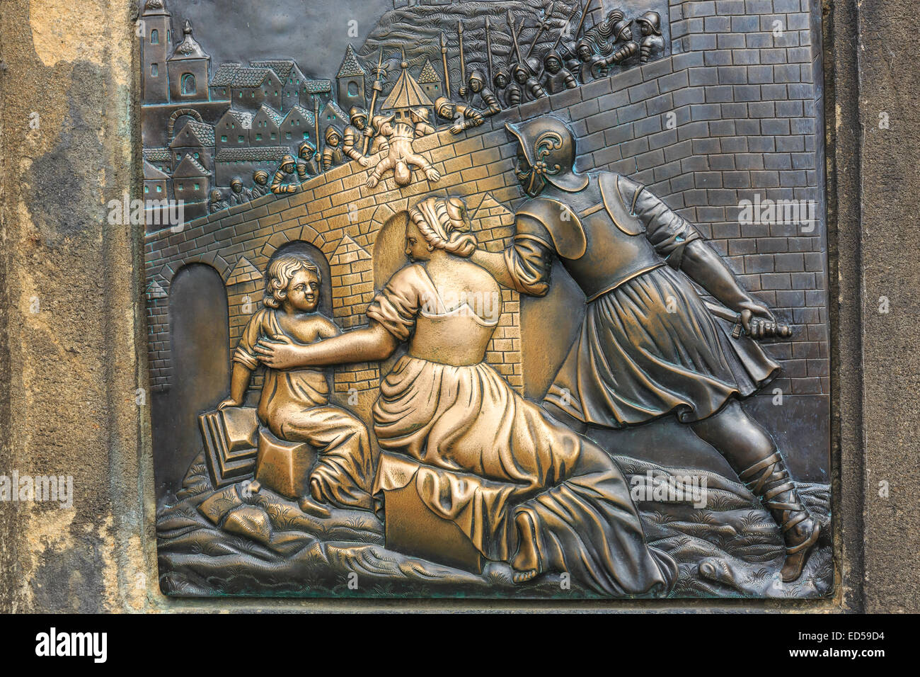Relief below the statue of St. John of Nepomuk on Charles Bridge in Prague, Czech Republic - Stock Image