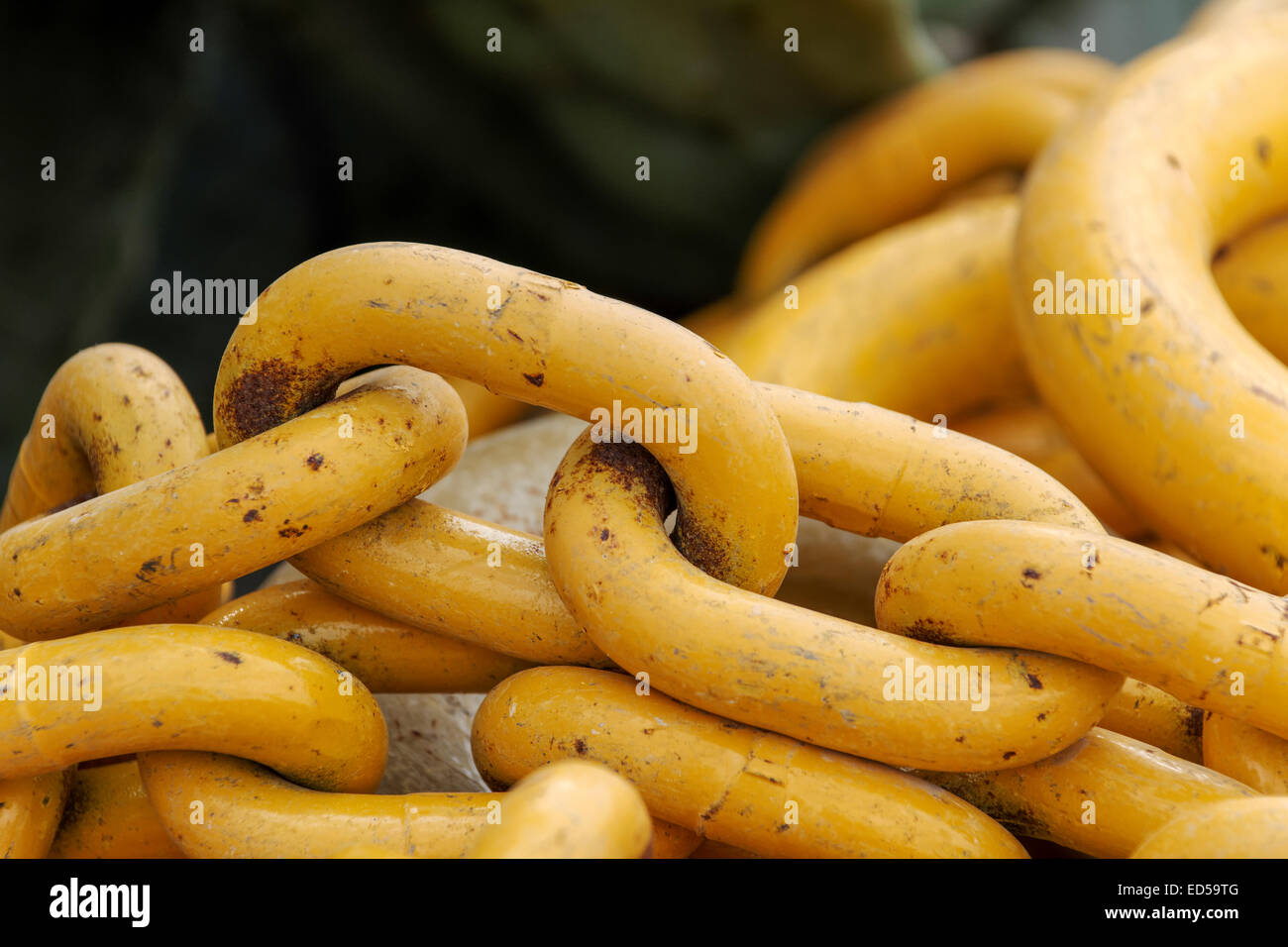 Stack of yellow chain links - Stock Image